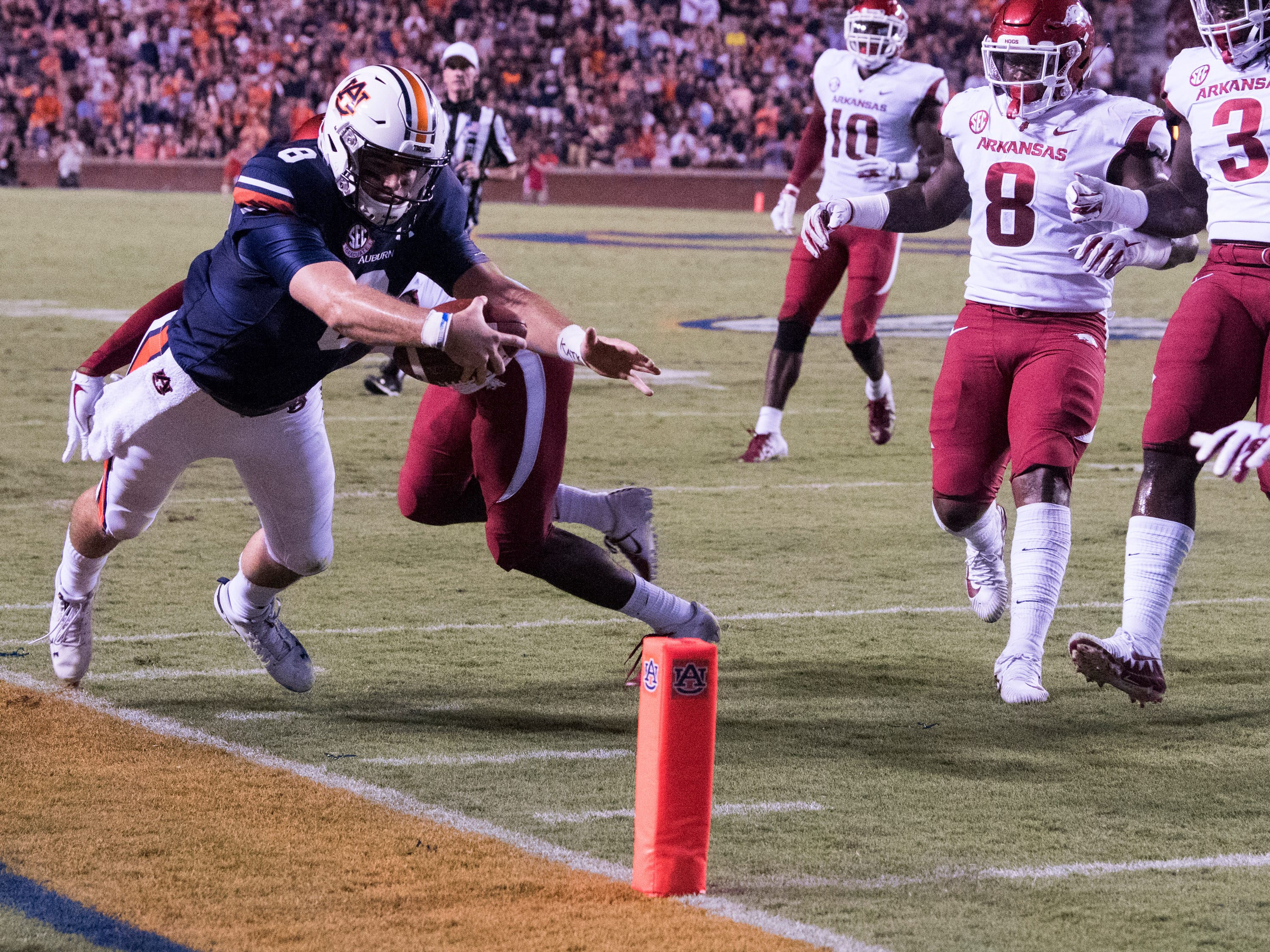 Auburn's Jarrett Stidham (8) dives short of the end zone to the 1-yard-line against  Arkansas at Jordan-Hare Stadium in Auburn, Ala., on Saturday, Sept. 21, 2018. Auburn leads Arkansas 17-0 at halftime.