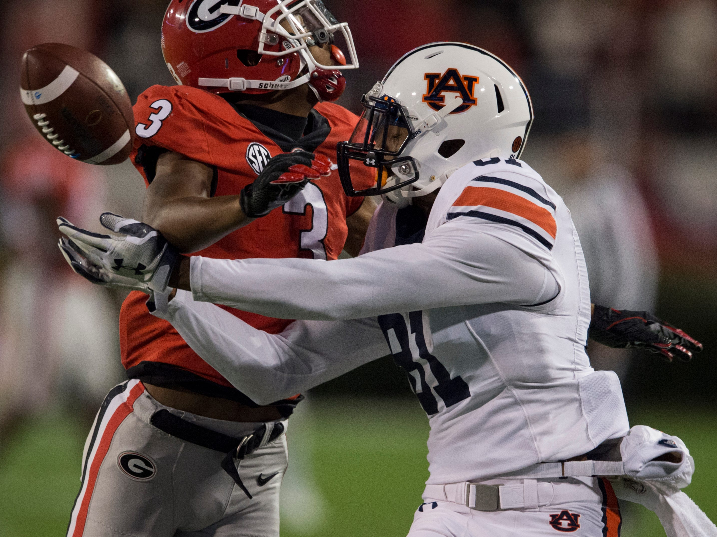 Georgia defensive back Tyson Campbell (3) is called for pass interference as he covers Auburn wide receiver Darius Slayton (81) at Sanford Stadium in Athens, Ga., on Saturday, Nov. 10, 2018. Georgia leads Auburn 20-10 at halftime.