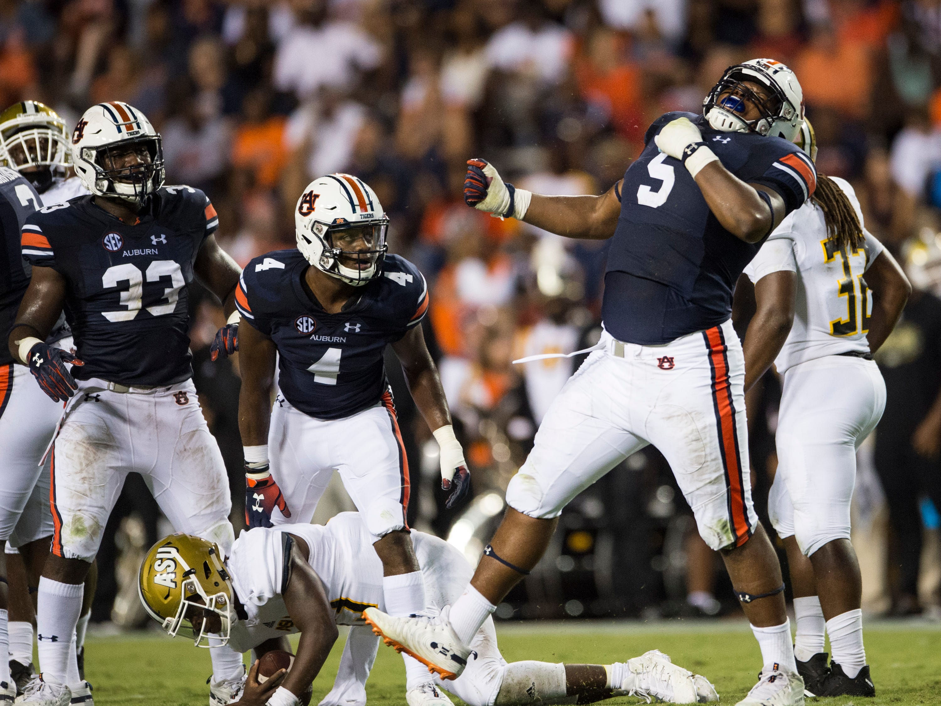 Auburn's Derrick Brown (5) celebrates after sacking Alabama State's Palmer Graham (13) at Jordan-Hare Stadium in Auburn, Ala., on Saturday, Sept. 8, 2018. Auburn defeated Alabama State 63-9.