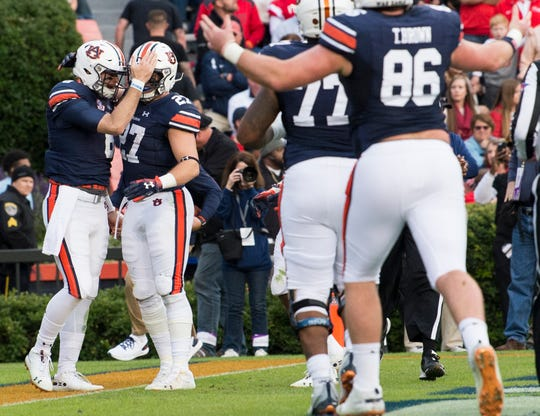 Auburn quarterback Jarrett Stidham (8) and fullback Chandler Cox (27) celebrate Stidham's touchdown run at Jordan-Hare Stadium in Auburn, Ala., on Saturday, Nov.. 17, 2018. Auburn leads Liberty 32-0 at halftime.