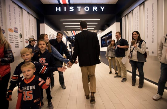 Auburn quarterback Jarrett Stidham (8) high fives fans during the Tiger Walk at Jordan-Hare Stadium on Saturday, Nov. 3, 2018.