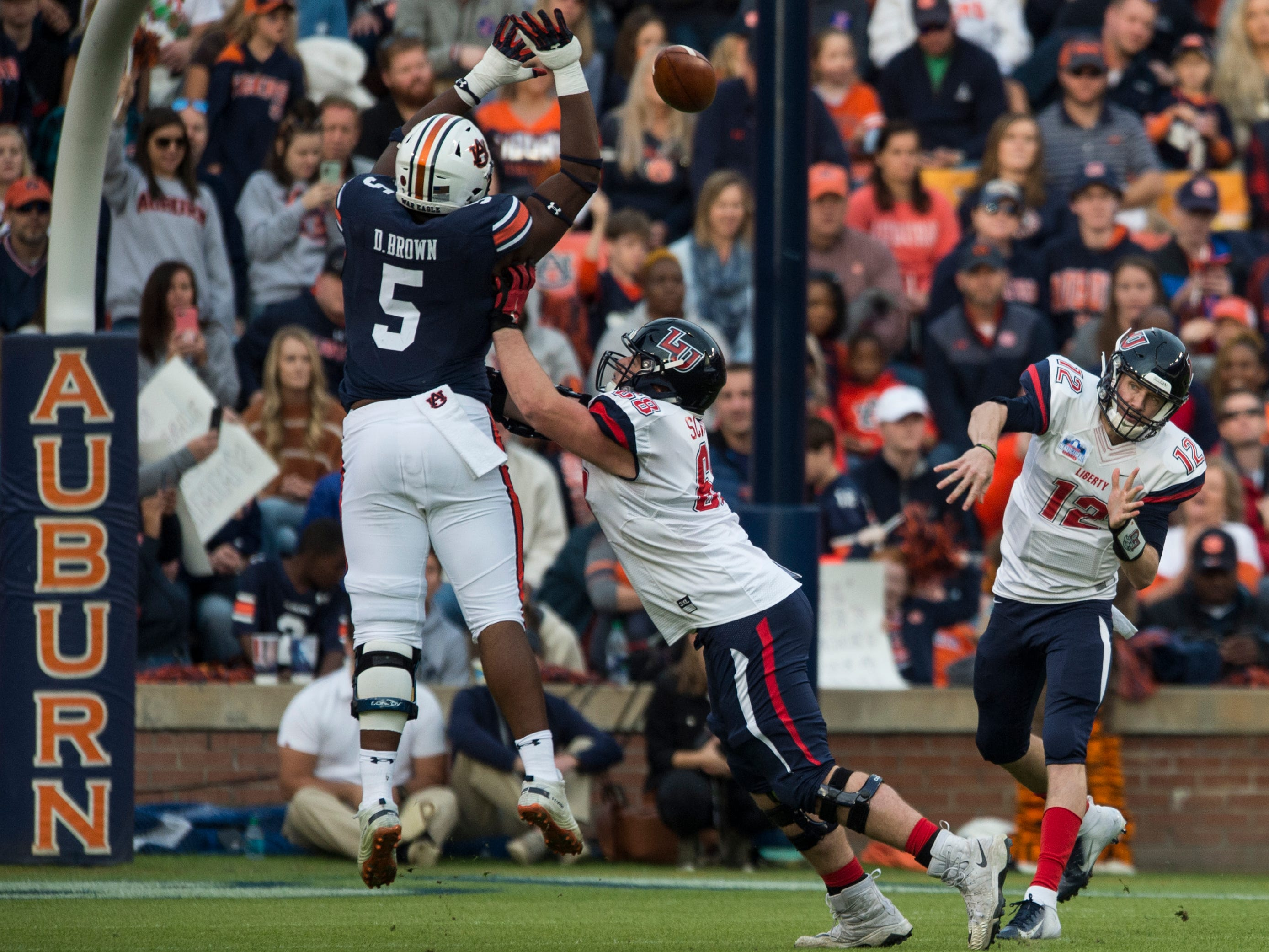 Auburn defensive lineman Derrick Brown (5) knocks down Liberty quarterback Stephen Calvert (12) pass at Jordan-Hare Stadium in Auburn, Ala., on Saturday, Nov.. 17, 2018. Auburn leads Liberty 32-0 at halftime.
