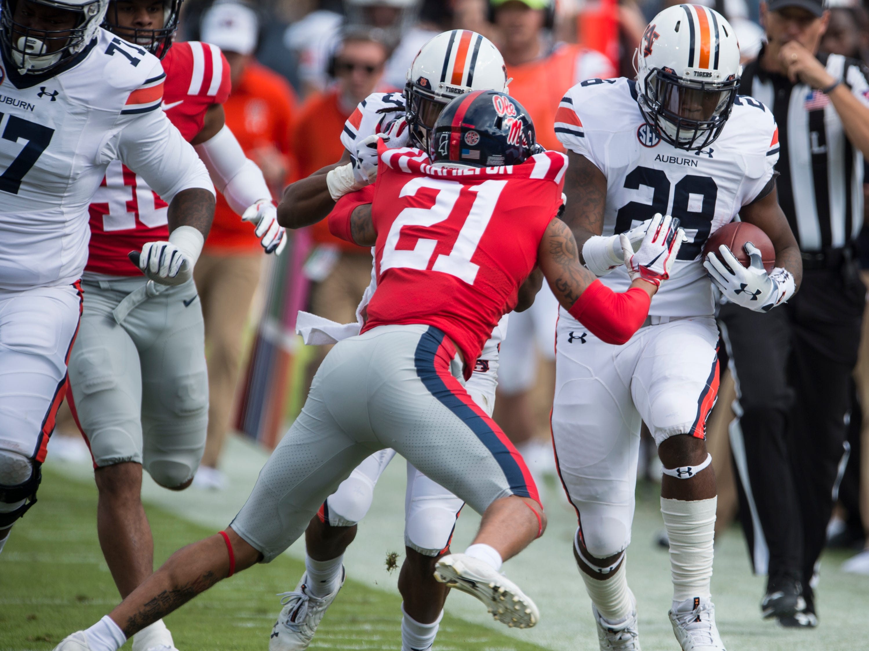 Auburn's JaTarvious Whitlow (28) toes the sideline as he runs the ball down the field at Vaught-Hemingway Stadium in Oxford, Miss., on Saturday, Oct. 20, 2018. Auburn defeated Ole Miss 31-16.
