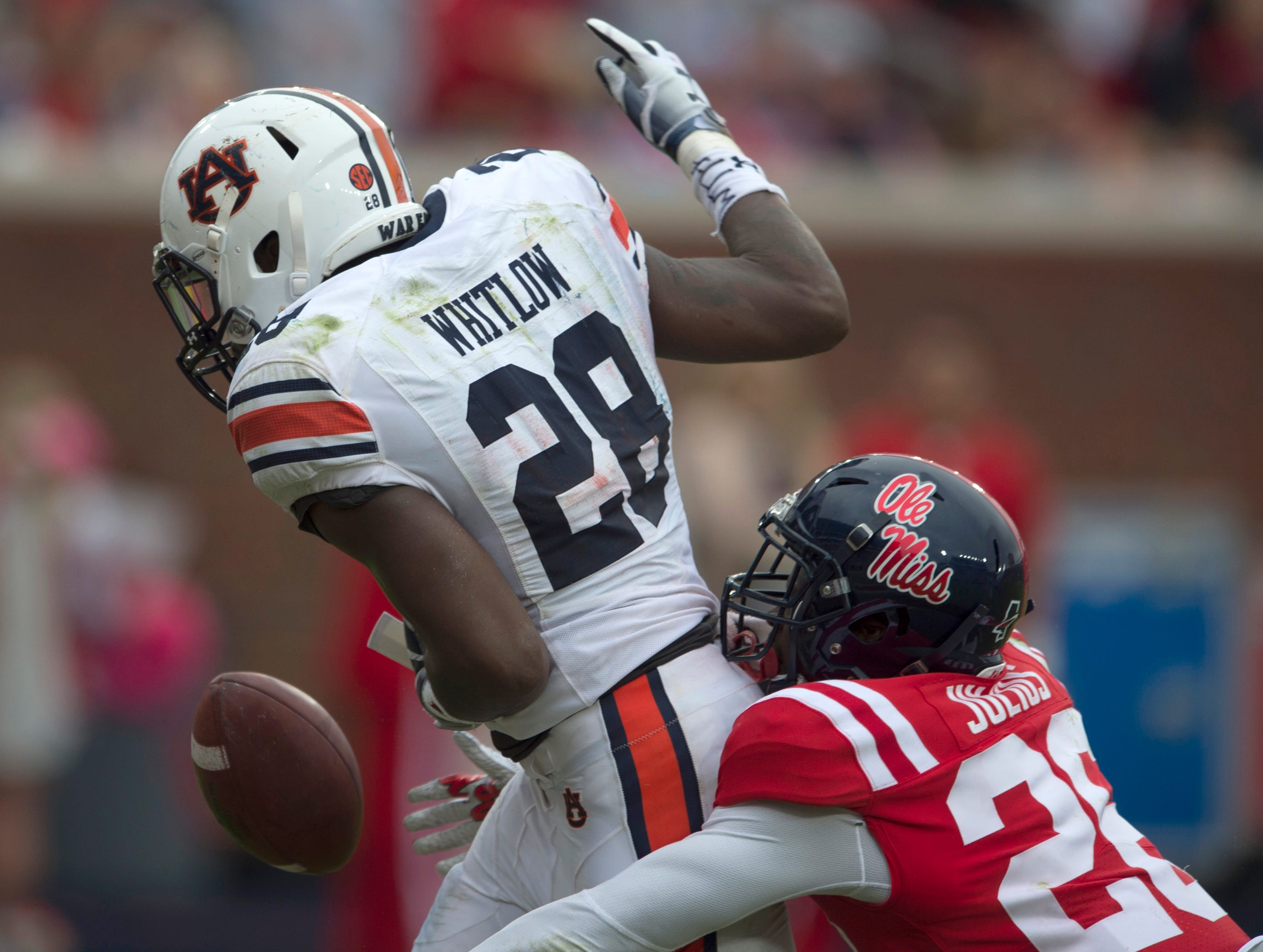 Auburn's JaTarvious Whitlow (28) has the ball knocked out by Ole Miss' Jalen Julius (26) on the one-yard line at Vaught-Hemingway Stadium in Oxford, Miss., on Saturday, Oct. 20, 2018. Auburn defeated Ole Miss 31-16.