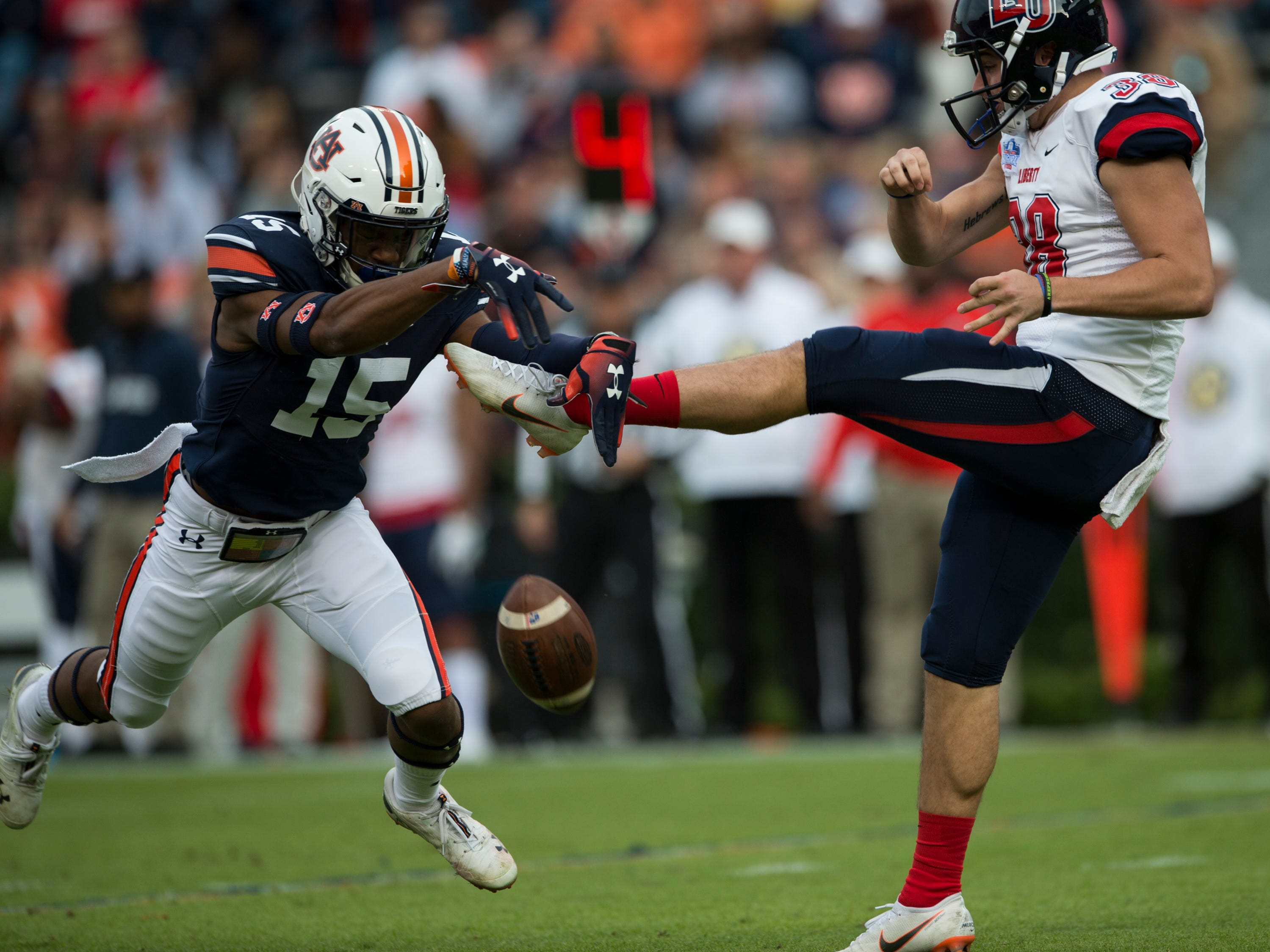 Auburn defensive back Jordyn Peters (15) blocks a Liberty punt at Jordan-Hare Stadium in Auburn, Ala., on Saturday, Nov.. 17, 2018. Auburn leads Liberty 32-0 at halftime. The ball rolled out of the back of the end zone for a safety.