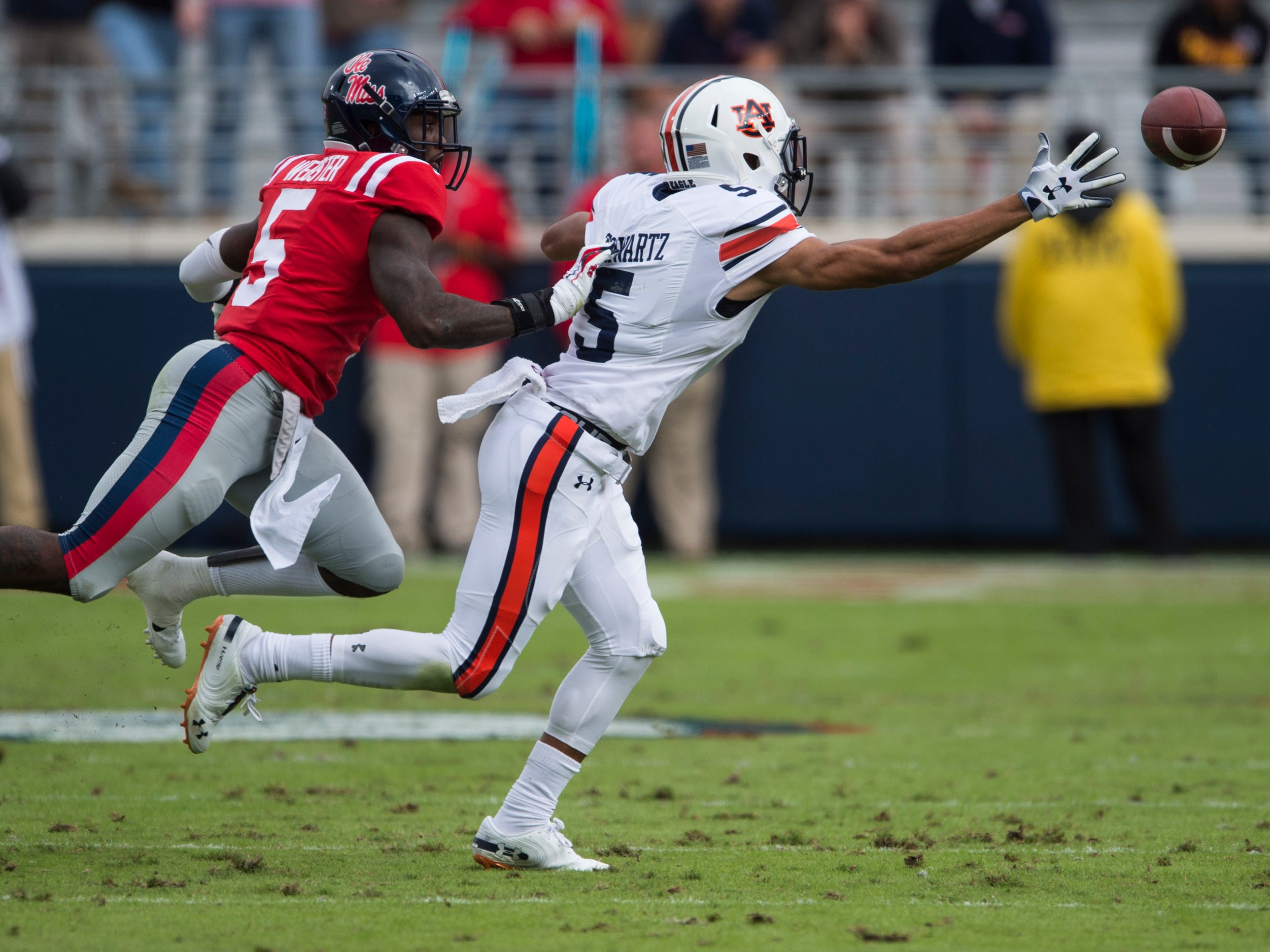 Auburn's Anthony Schwartz (5) stretches for an over thrown ball against Ole Miss at Vaught-Hemingway Stadium in Oxford, Miss., on Saturday, Oct. 20, 2018. Auburn leads Ole Miss 10-6 at halftime.