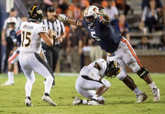 Auburn's Derrick Brown (5) leaps over Southern Miss' Jaylond Adams (2) and sacks Southern Miss' Jack Abraham (15) at Jordan-Hare Stadium in Auburn, Ala., on Saturday, Sept. 29, 2018. Auburn defeated  Southern Miss 24-13.