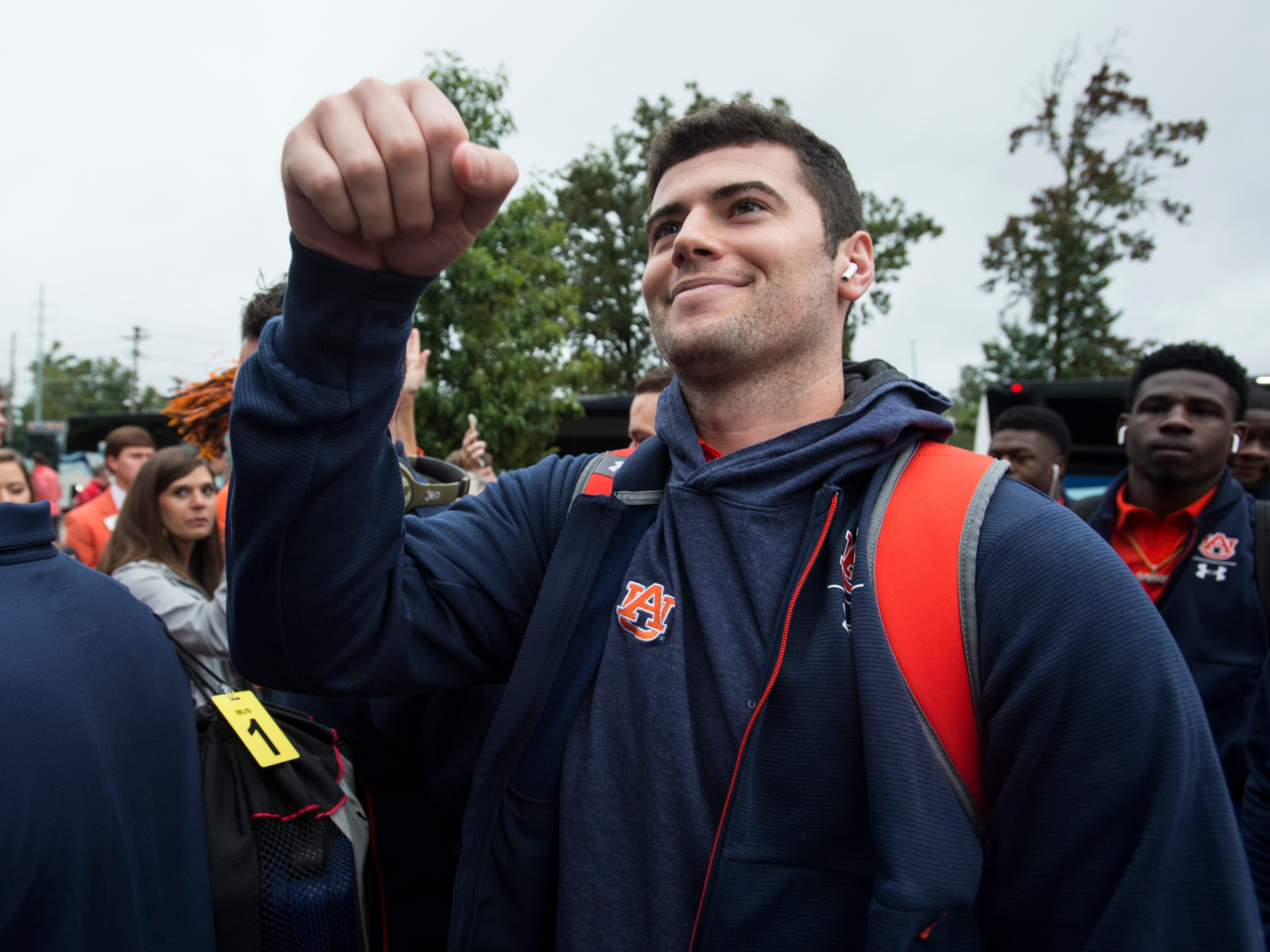 Auburn's Jarrett Stidham (8) fist bumps a fan during the Tiger Walk at Vaught-Hemingway Stadium in Oxford, Miss., on Saturday, Oct. 20, 2018.