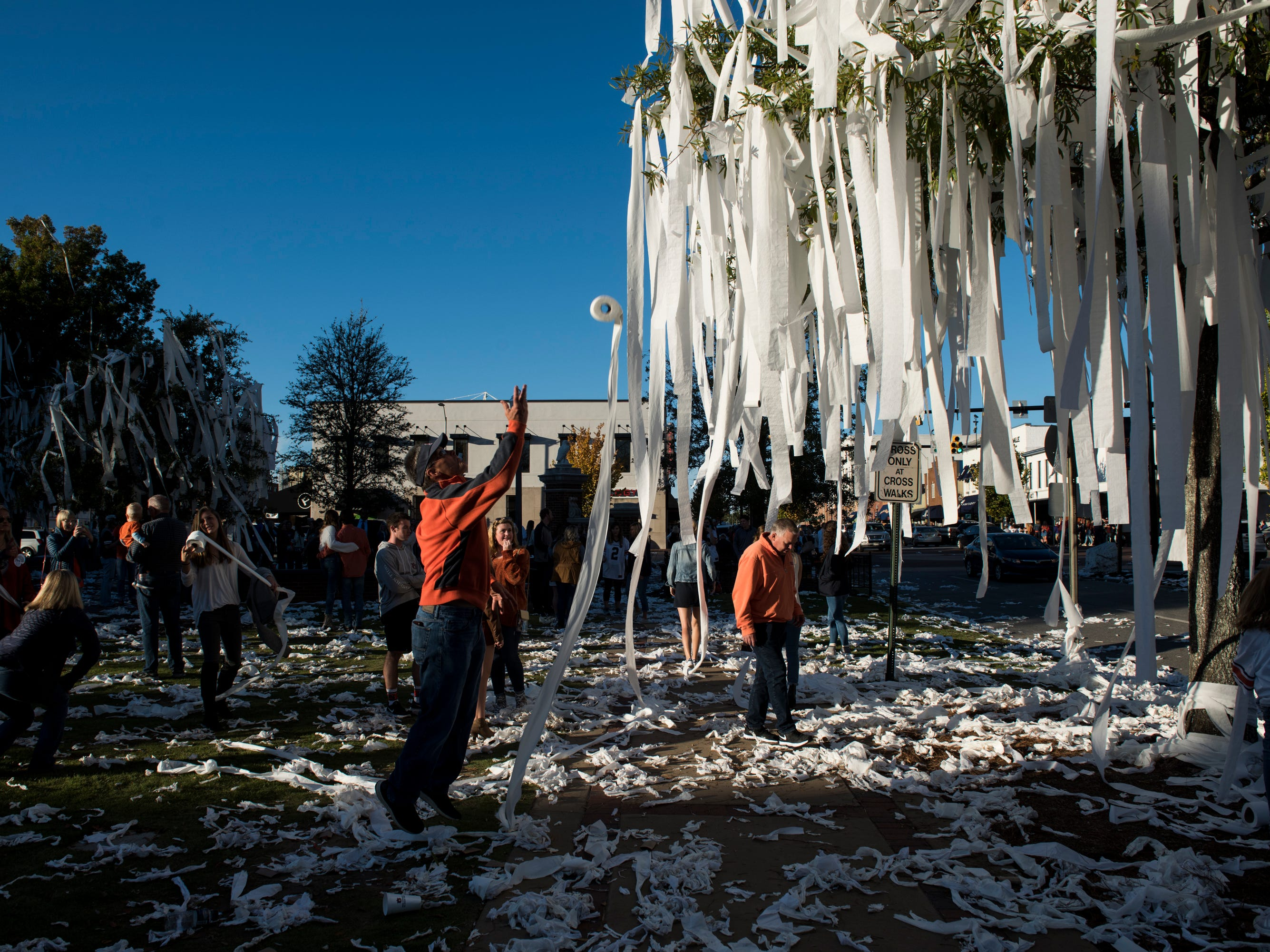Auburn fans 'roll' the oak trees at Toomer's Corner after Auburn defeated Texas A&M 28-24 in Auburn, Ala. on Saturday, Nov. 3, 2018.