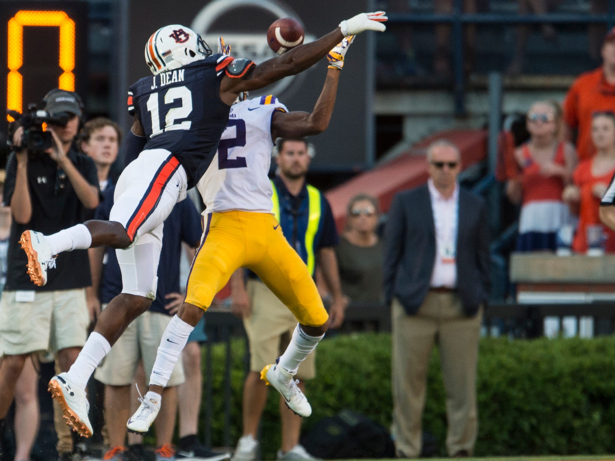 Auburn's Jamel Dean (12) is called for pass interference 0n LSU's Justin Jefferson (2) at Jordan-Hare Stadium in Auburn, Ala., on Saturday, Sept. 15, 2018. LSU defeated Auburn 22-21. The penalty set up the game winning field goal.