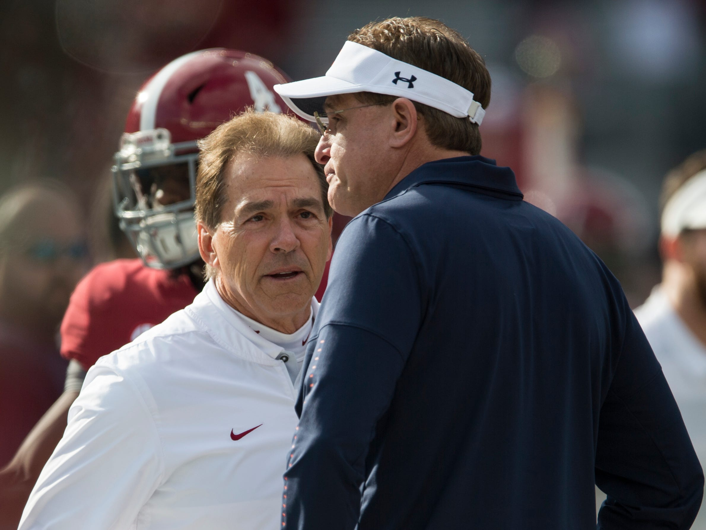 Auburn head coach Gus Malzahn and Alabama head coach Nick Saban talk as their teams warm up before the Iron Bowl at Bryant-Denny Stadium in Tuscaloosa, Ala., on Saturday, Nov. 24, 2018.