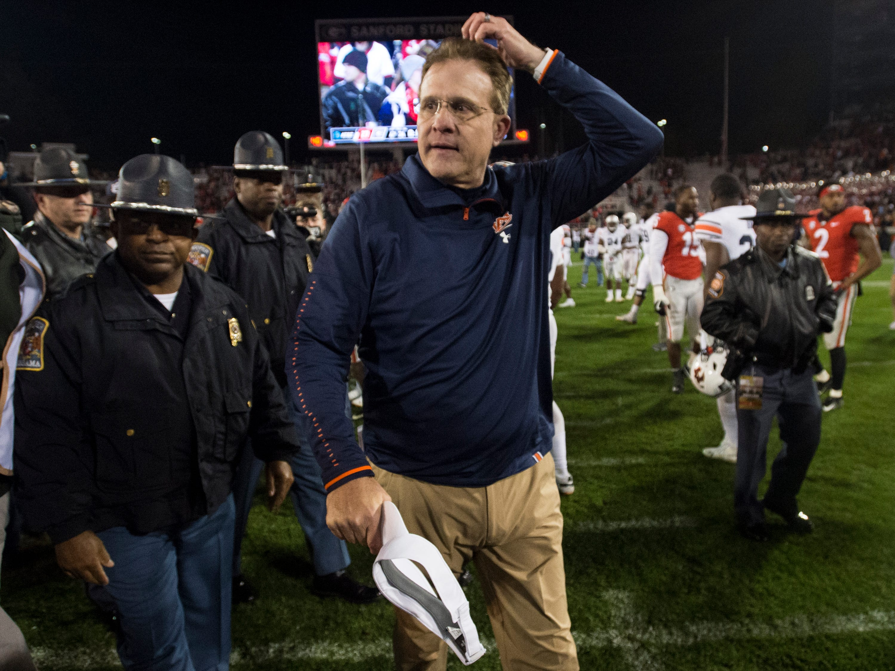 Auburn head coach Gus Malzahn adjusts his hair as he walks off the field after the game at Sanford Stadium in Athens, Ga., on Saturday, Nov. 10, 2018. Georgia defeated Auburn 27-10.