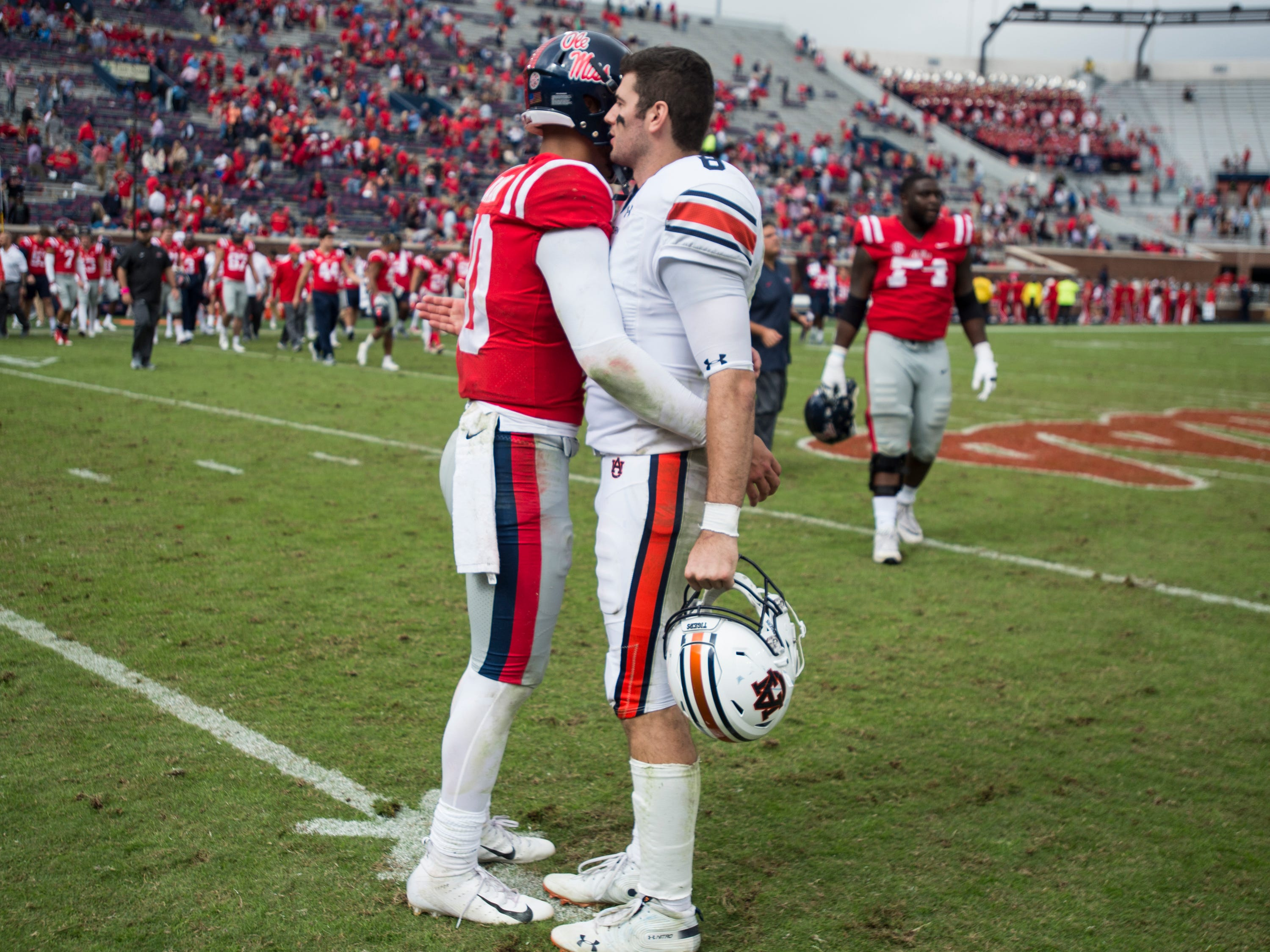 Ole Miss' Jordan Ta'amu (10) and Auburn's Jarrett Stidham (8) hug on the field after the game at Vaught-Hemingway Stadium in Oxford, Miss., on Saturday, Oct. 20, 2018. Auburn defeated Ole Miss 31-16.