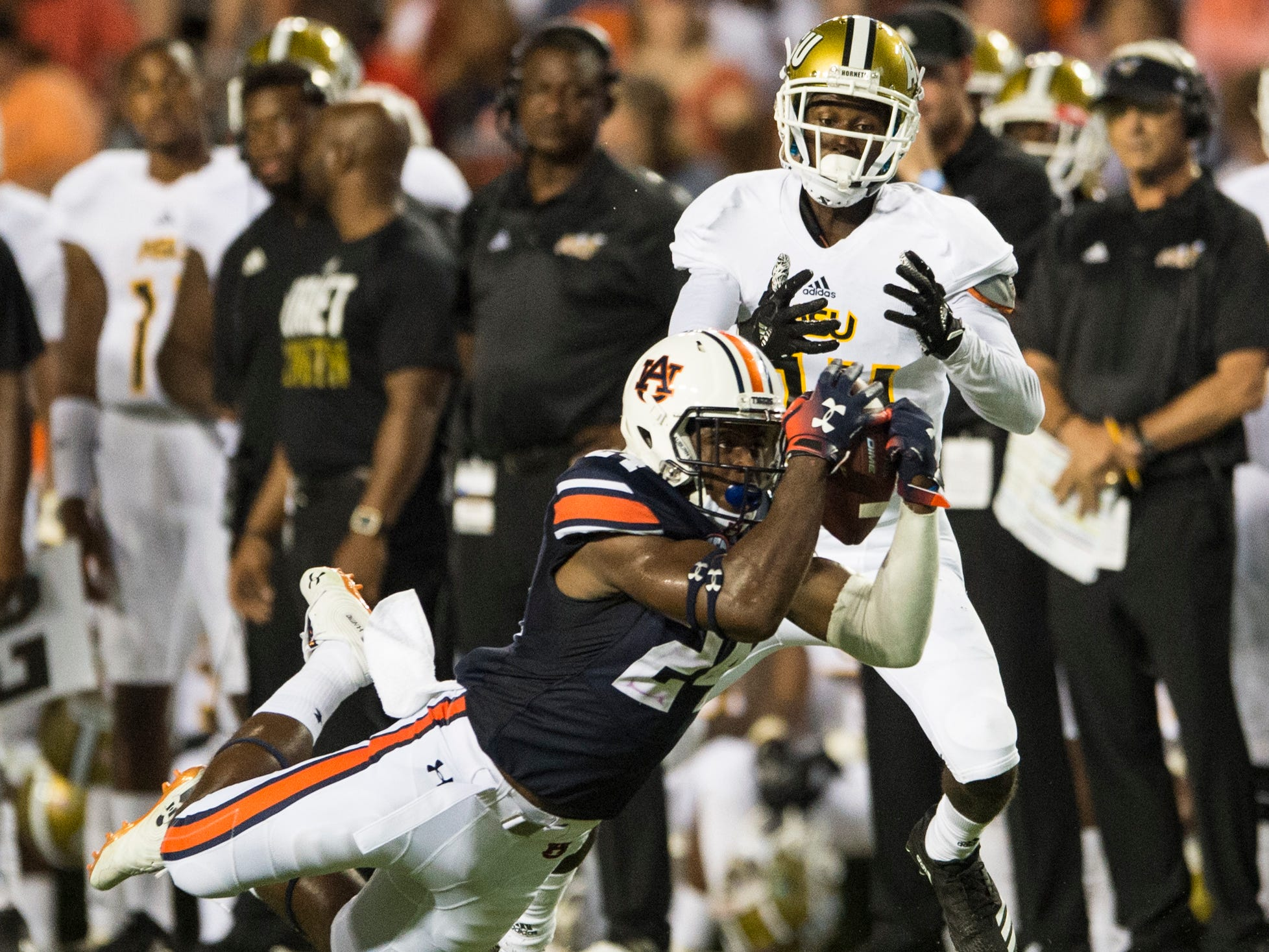 Auburn's Daniel Thomas (24) pulls down an interception against Alabama State at Jordan-Hare Stadium in Auburn, Ala., on Saturday, Sept. 8, 2018. Auburn leads Alabama State 42-2 at halftime.