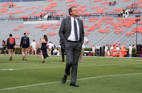 Auburn head coach Gus Malzahn joins his team on the field after the Tiger Walk at Jordan-Hare Stadium in Auburn, Ala., on Saturday, Sept. 21, 2018.