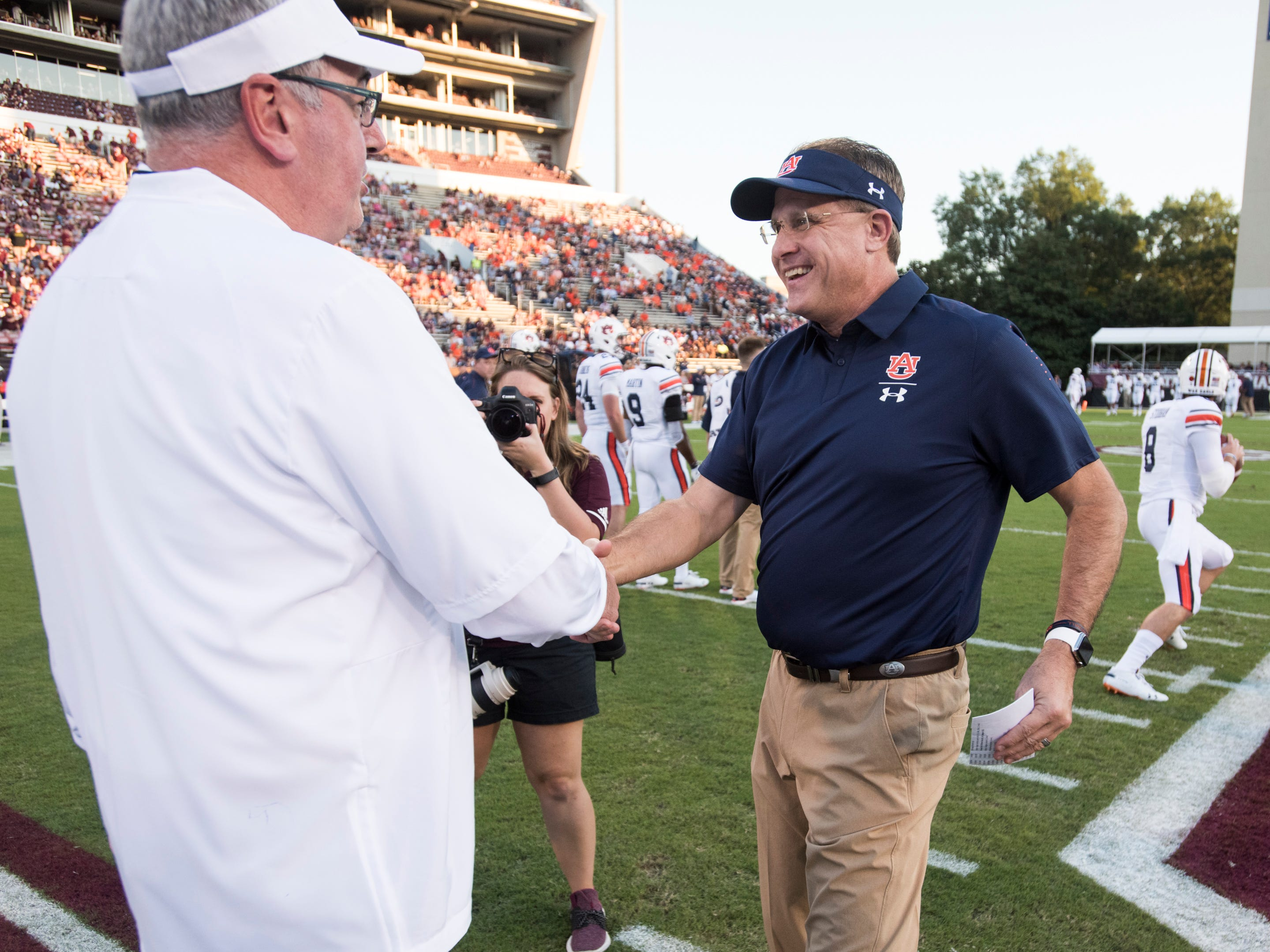 Auburn head coach Gus Malzahn shakes hands with Mississippi State head coach Joe Moorhead during warm ups at Davis Wade Stadium in Starkville, Miss., on Saturday, Oct. 6, 2018.