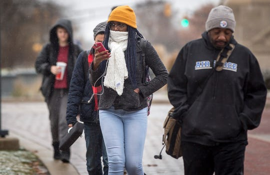 Ball State University students wander through the winter mix in this file photo.