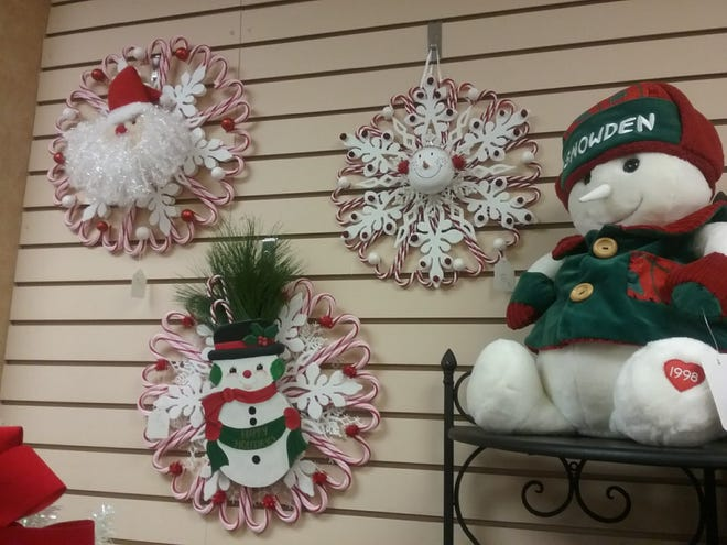 Holiday wreaths made by a member of Psi Iota Xi will be among the items for sale at the Bargain Box's Holiday Boutique.