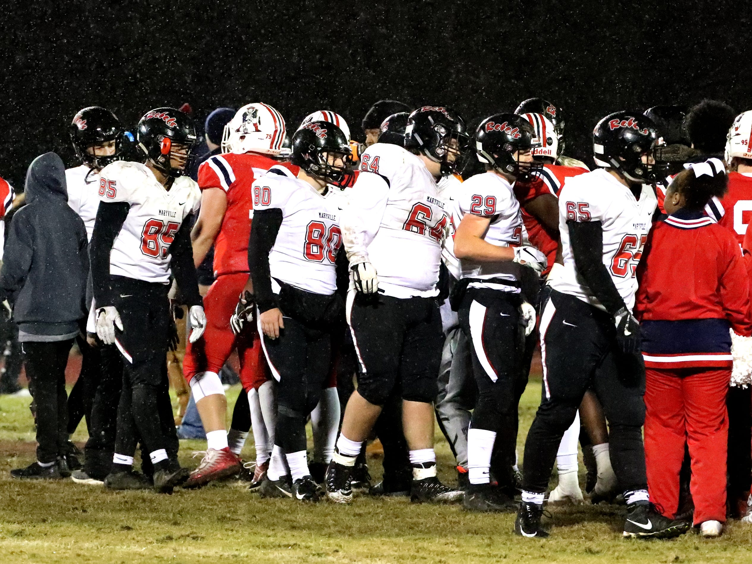 Maryville and Oakland shake hands after the game  at Oakland in Murfreesboro, on Friday, Aug. 23 2018, during the 6A playoffs.