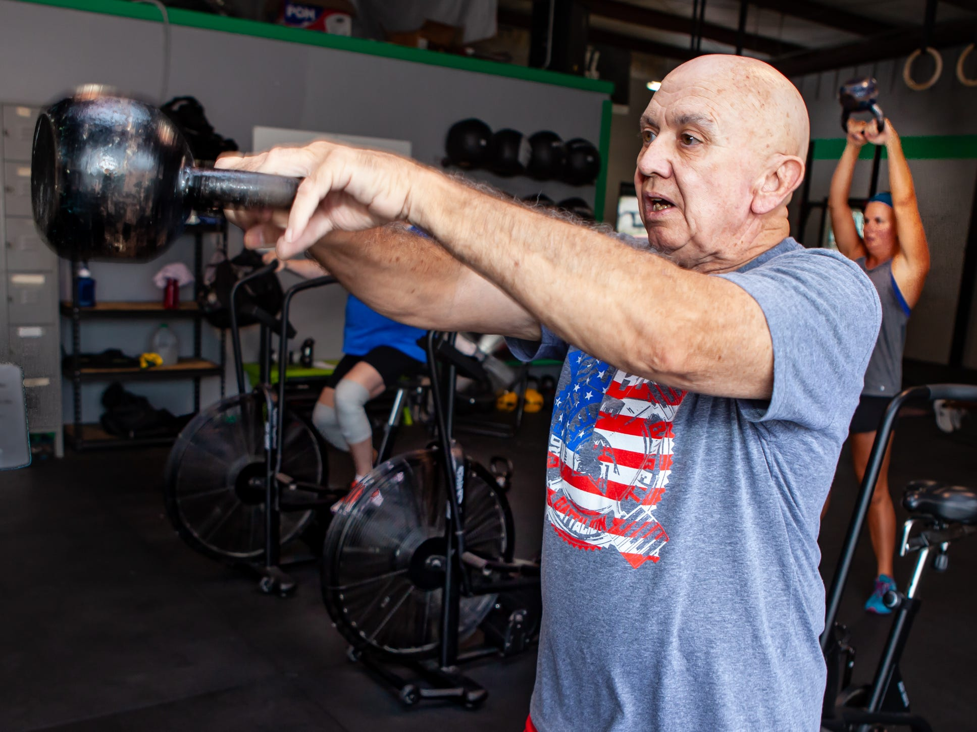 Alton Miles works out at the CrossFit Barbell Batallion in downtown Murfreesboro.