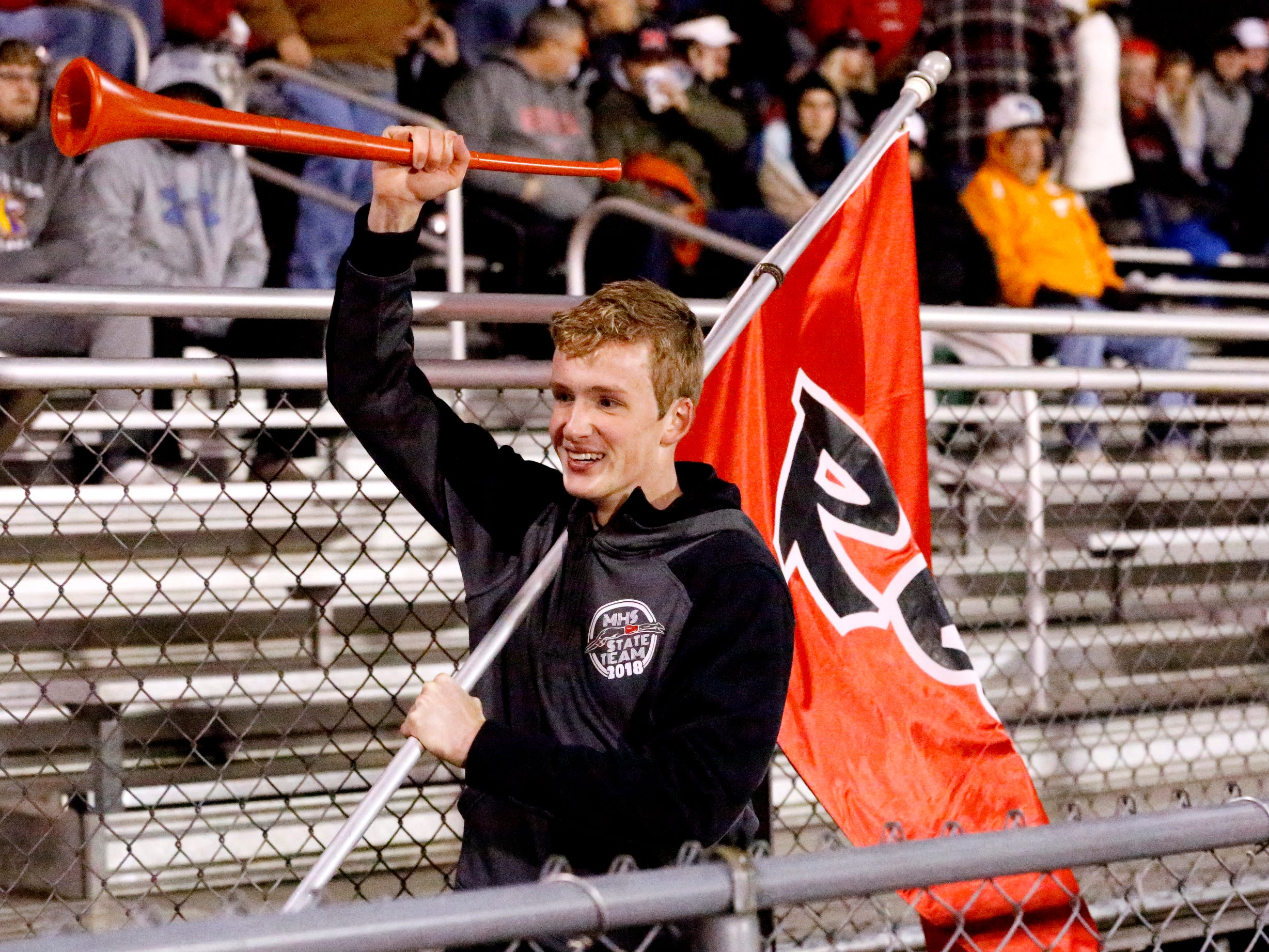 Maryville junior Caleb Fikes pumps up the Maryville crowd before the start of the game between Oakland and Maryville in Murfreesboro, on Friday, Aug. 23 2018, during the 6A playoffs.