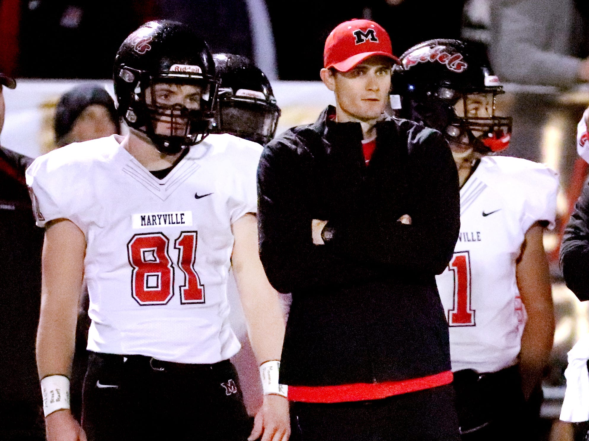 Maryville's head football coach Derek Hunt on the sidelines with junior Brody Sloan in Murfreesboro, on Friday, Aug. 23 2018, during the 6A playoffs against Oakland.
