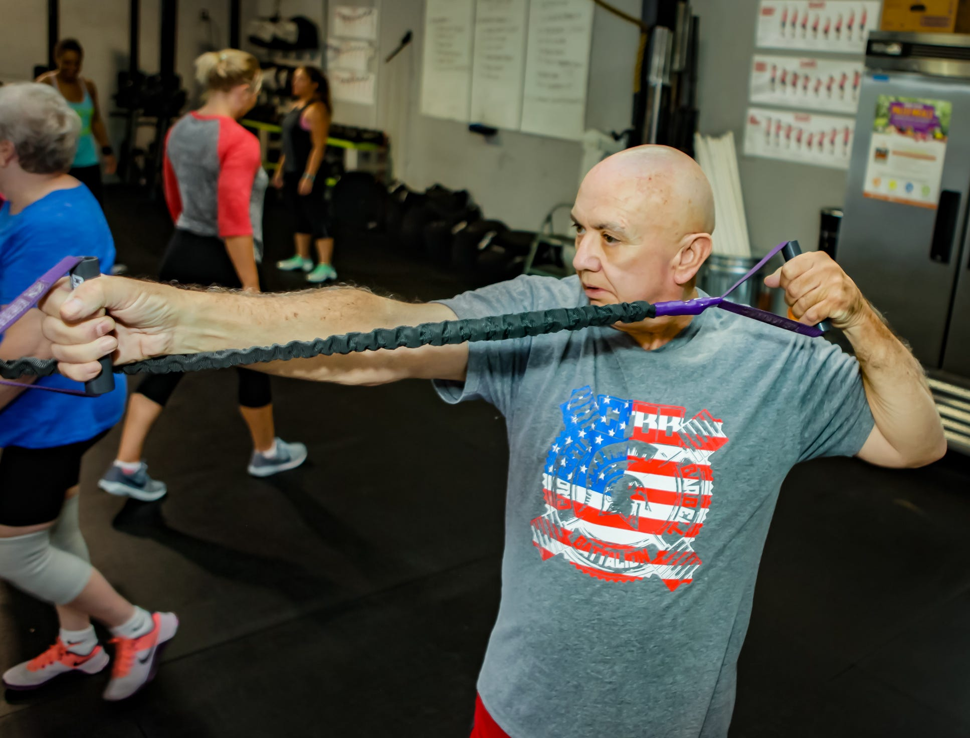 Alton Miles, 72, does a workout using crossover symmetry bands at the CrossFit Barbell Batallion in downtown Murfreesboro.