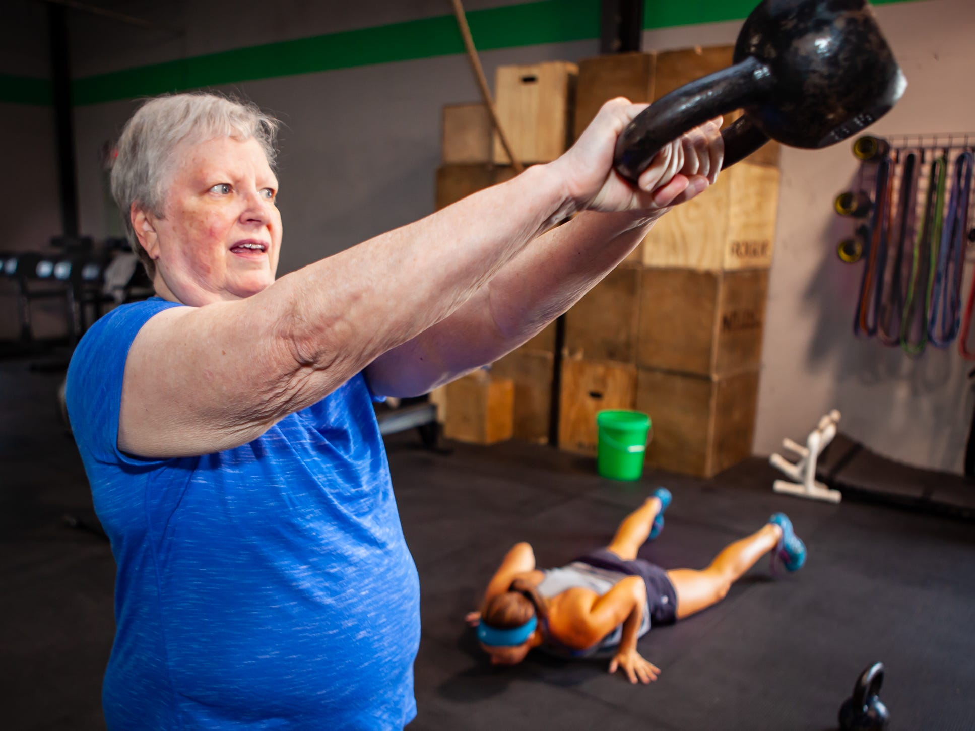 Lynda Miles works out at the CrossFit Barbell Batallion in downtown Murfreesboro. \