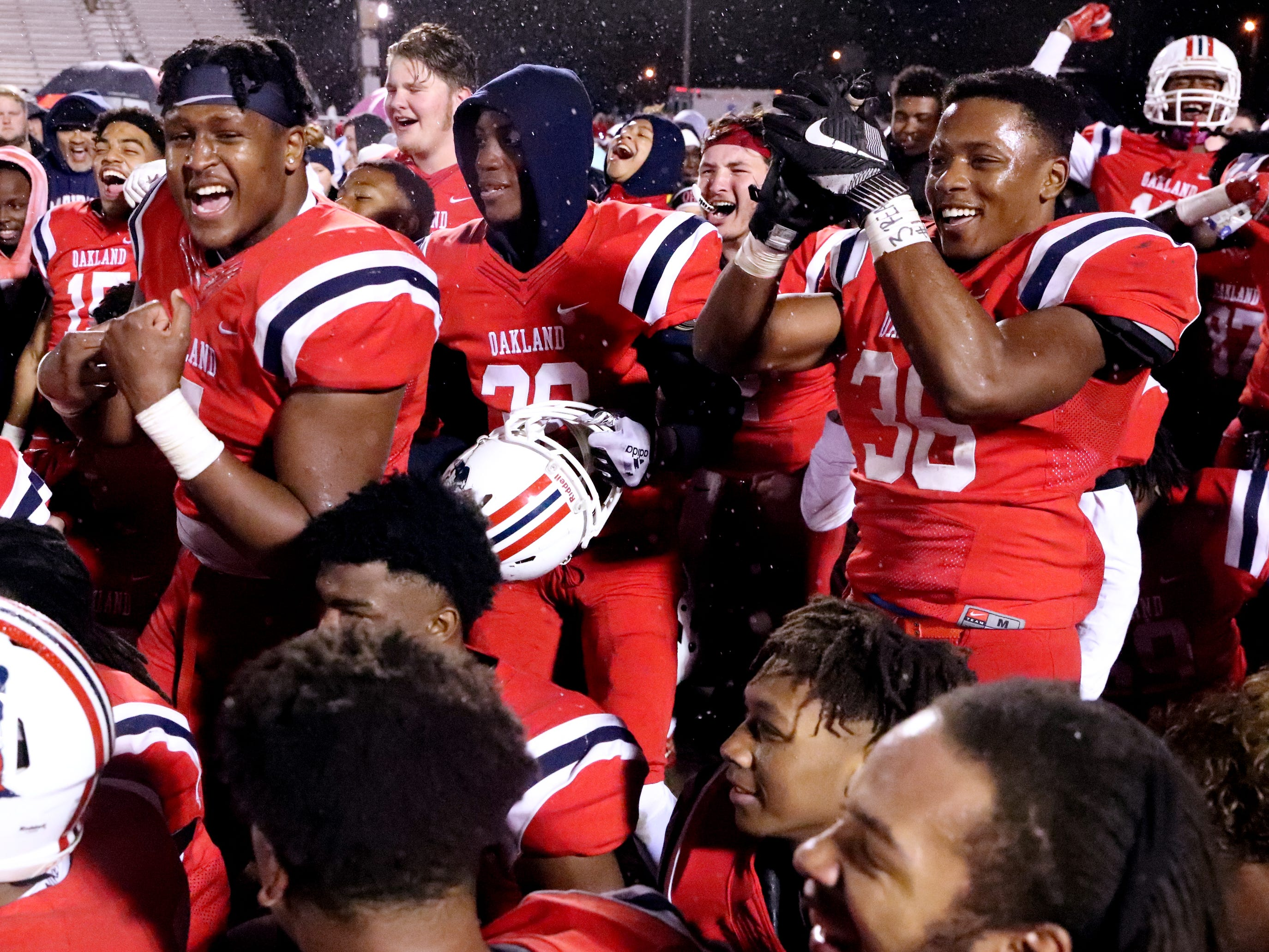 Oakland players celebrates after beating Maryville 38-0 at Oakland in Murfreesboro, on Friday, Aug. 23 2018, during the 6A playoffs and advancing to the State Tournament next week.