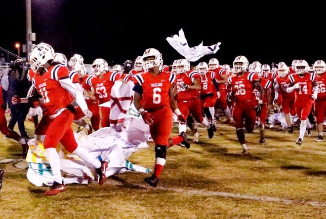 Oakland players take the field before the game against Maryville on Friday.