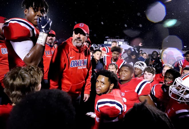 Oakland's coach Kevin Creasy talks with his players after they beat Maryville 38-0 at Oakland in Murfreesboro, on Friday, Nov. 23 2018, during the 6A playoffs.