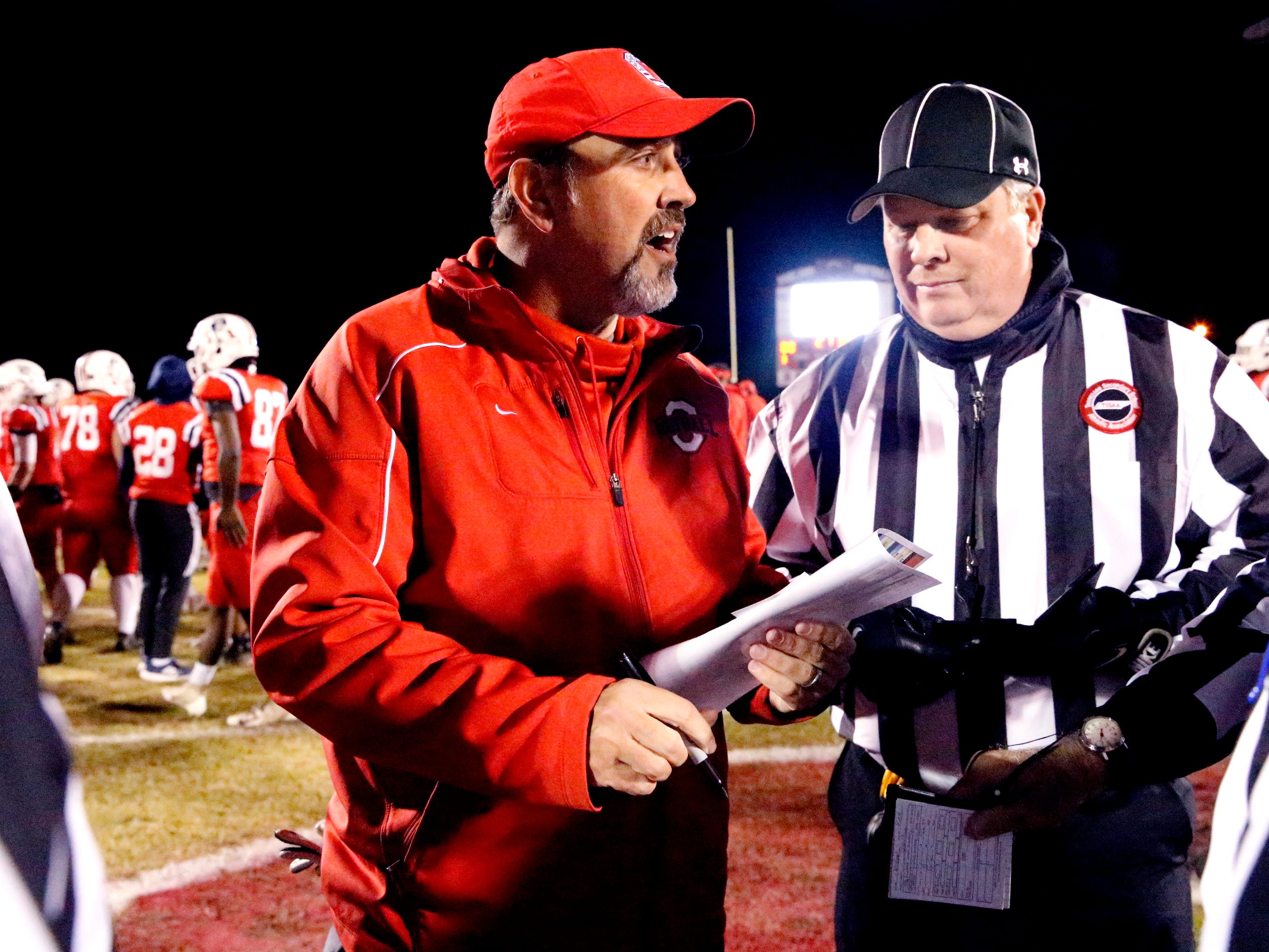Oakland head football coach Kevin Creasy takes with officials before the start of the game against Maryville in Murfreesboro, on Friday, Aug. 23 2018, during the 6A playoffs.