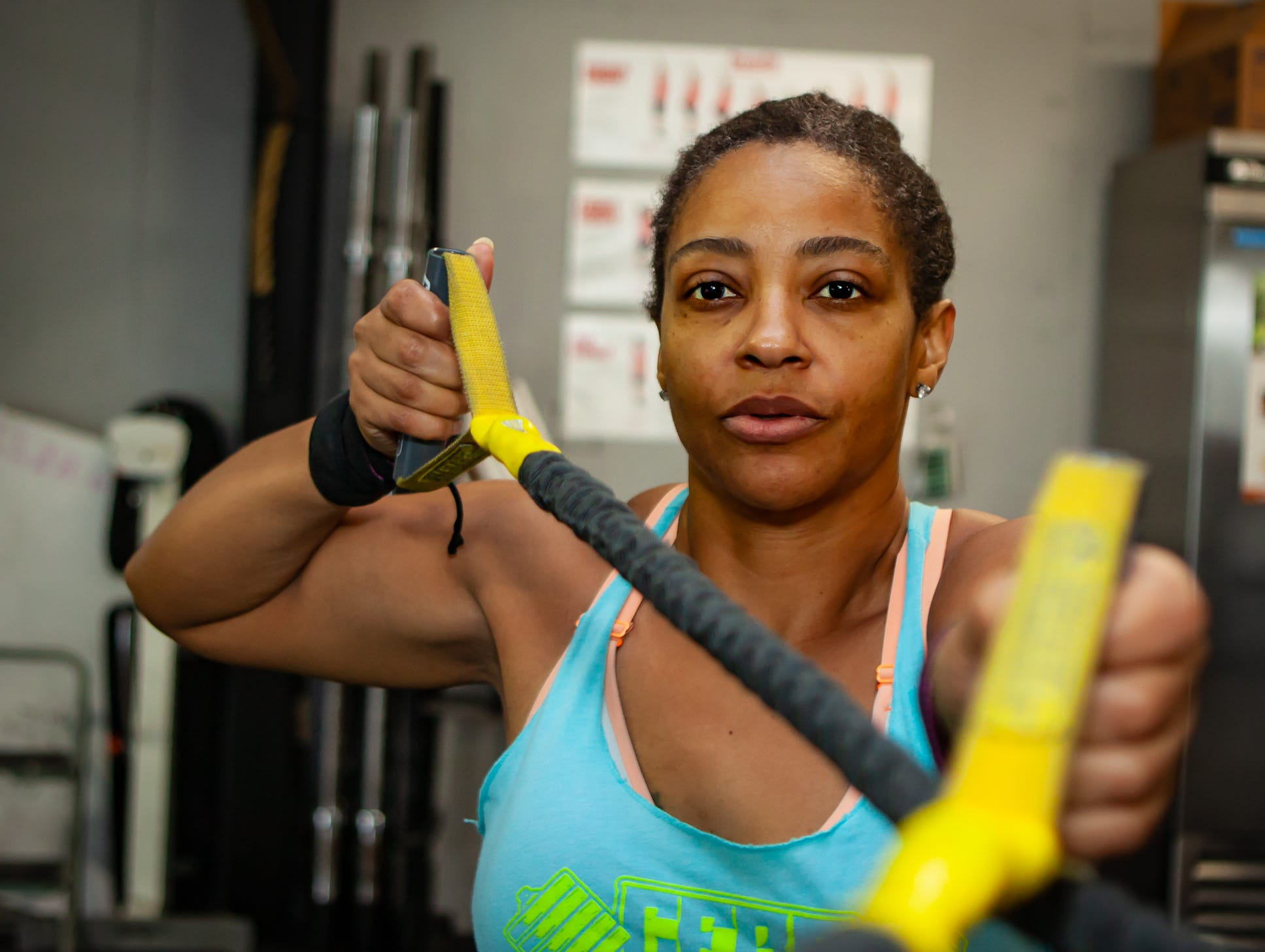 CrossFit Barbell Batallion athlete Pam McCluney works out in downtown Murfreesboro.