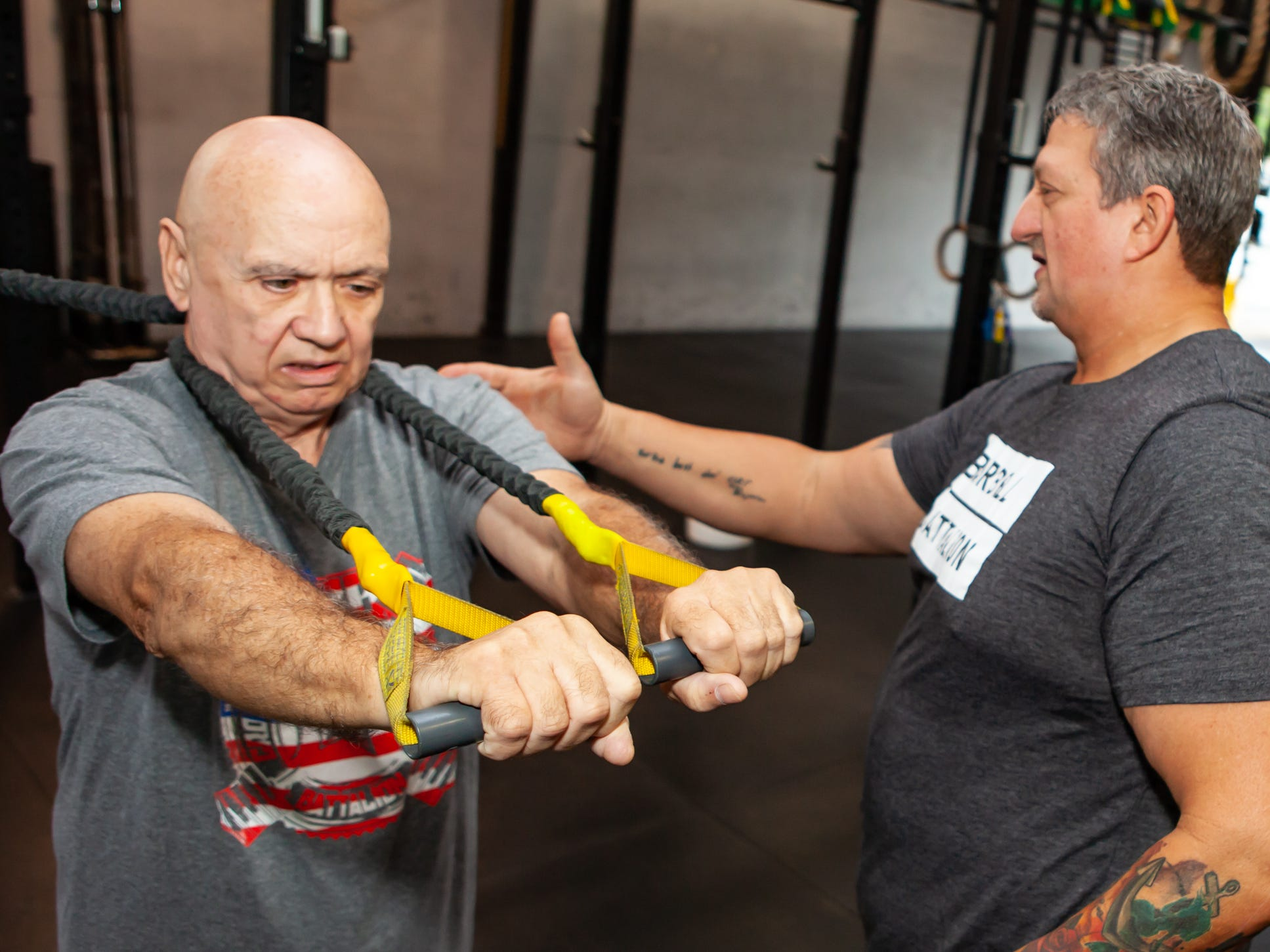 Alton Miles works out with son Tim Miles at CrossFit Barbell Batallion in downtown Murfreesboro.