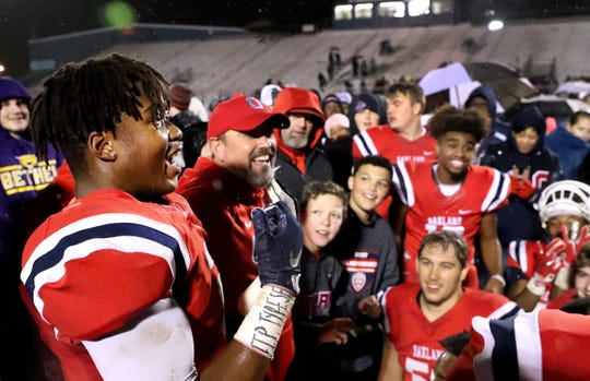 Oakland's Tekoy Randolph celebrates after beating Maryville 38-0 at Oakland in Murfreesboro, on Friday, Aug. 23 2018, during the 6A playoffs and advancing to the State Tournament next week.