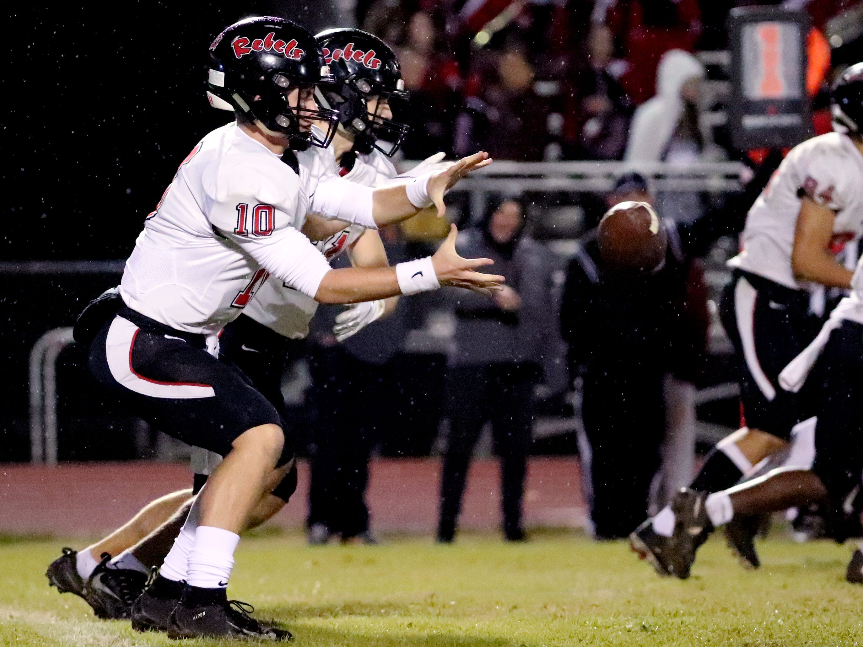Maryville's quarterback (10) grabs a snap at Oakland in Murfreesboro, on Friday, Aug. 23 2018, during the 6A playoffs against Oakland.