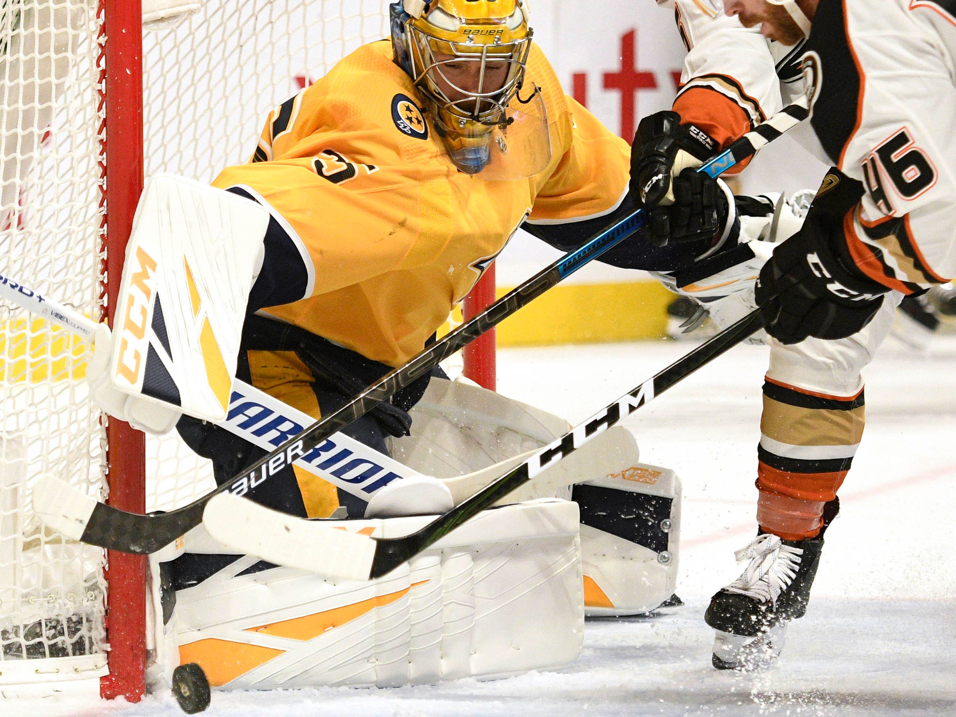 Nashville Predators goaltender Pekka Rinne (35) makes a save on a shot from Anaheim Ducks center Ben Street (46) during the second period at Bridgestone Arena.