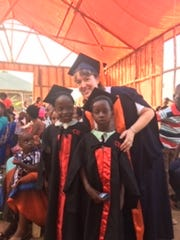 Chosen With a Mission, a nonprofit organization launched by an Ashland City family, supports students in Uganda. Nancy Johnson smiles with graduating students.