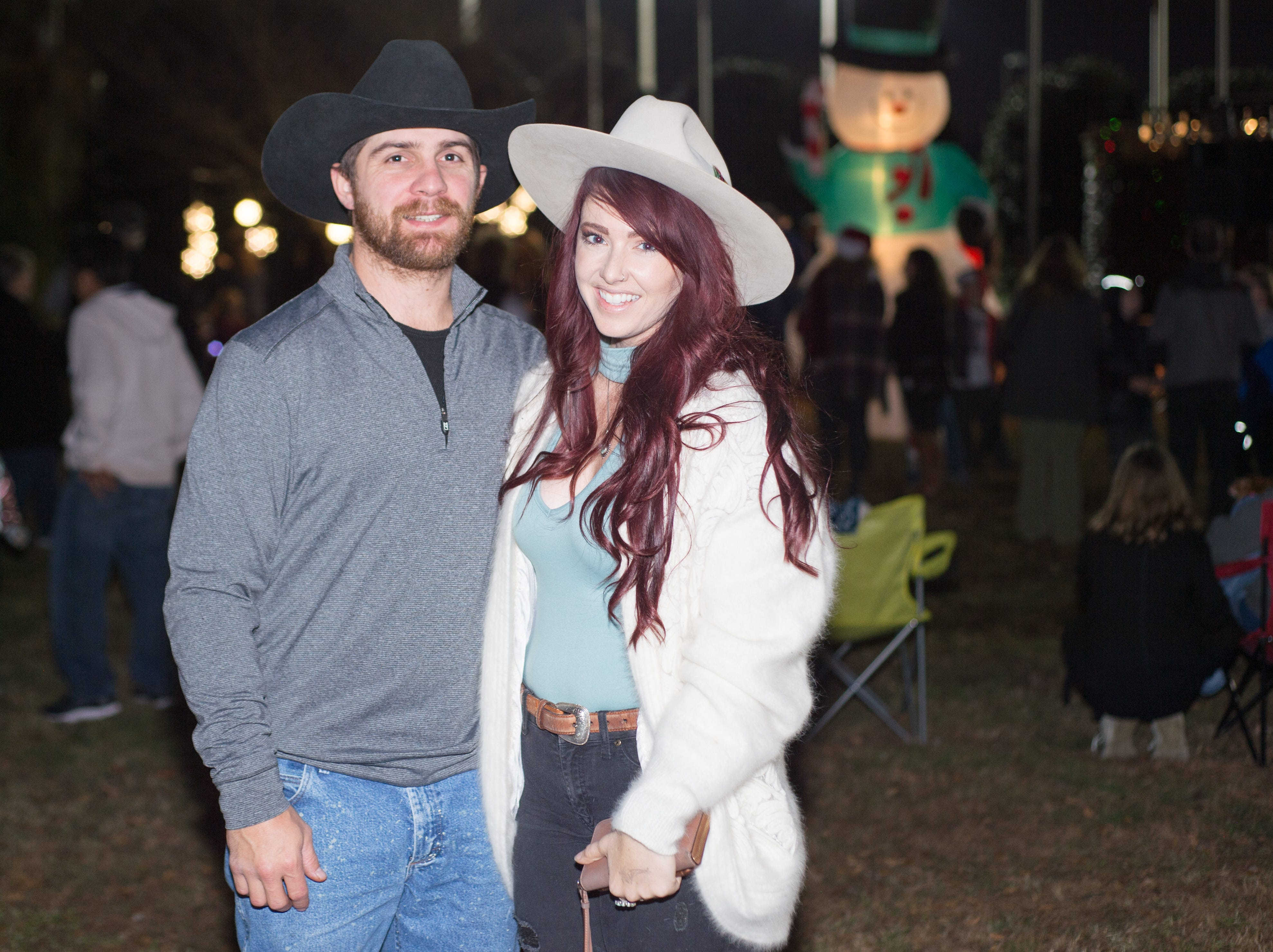 Chris Hieber and Liz Hill pause for a photograph during the Hendersonville HolidayFest Annual Tree Lighting Ceremony at Memorial Park on Sunday, Nov. 25.