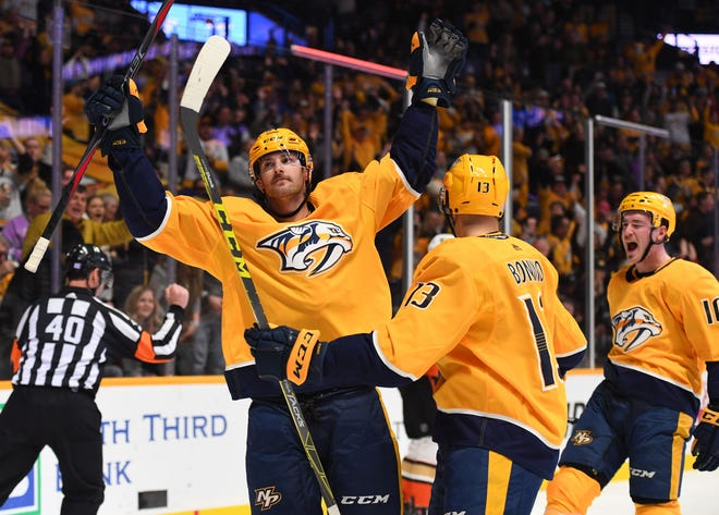 The Predators' Austin Watson (51) celebrates with teammates Nick Bonino (13) and Colton Sissons (10) after a goal against the Ducks on Nov. 25.