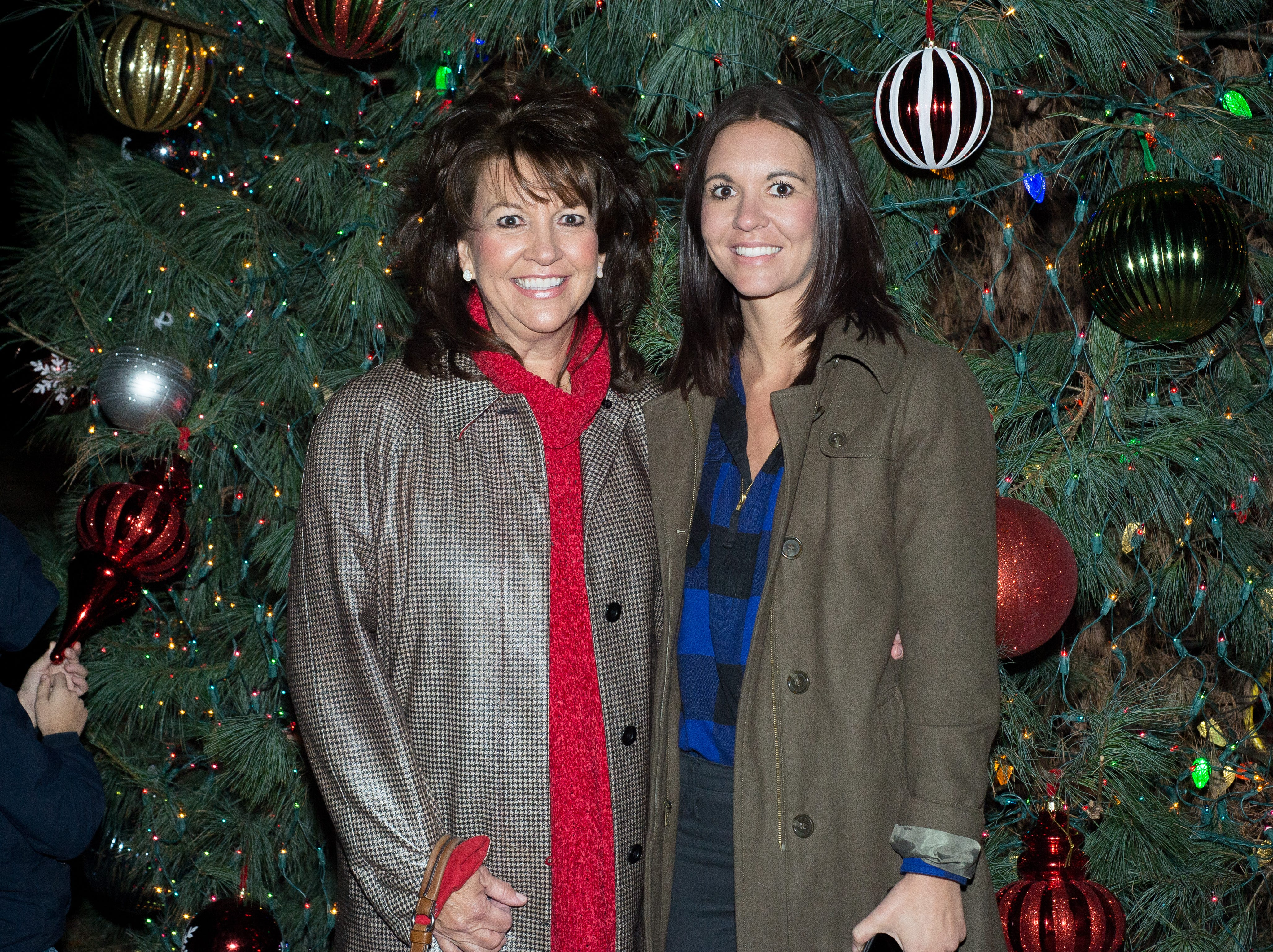 Ellen Smithmier and Joy Gregory, with Southern Breeze Staging & Design, stand in front of the tree that they decorated during the Hendersonville HolidayFest Annual Tree Lighting Ceremony at Memorial Park on Sunday, Nov. 25.