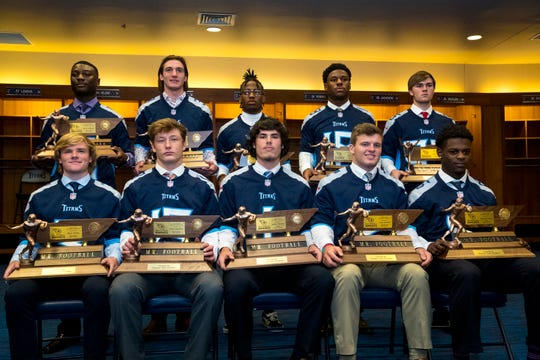 The nine Mr. Football winners and Kicker of the Year winner pose for a group picture in the Titan's locker room, during the 2018 Titans Mr. Football Awards Dinner at Nissan Stadium in Nashville on Sunday, Nov. 25, 2018.  Left to right, front row, Bryce Hanley Division 1 Class 1A, Aaron Swafford Division 1 Class 2A, Walker Russell Division 1 Class 3A, Cade Ballard Division 1 Class 4A, Deshawn Page Division 1 Class 5A, back row, Devon Starling Division 1 Class 6A, Stone Norton Division 2 Class A, Eric Gray Division 2 Class AA, Maurice Hampton Division 2 Class AAA, Garrett Taylor Kicker of the Year.