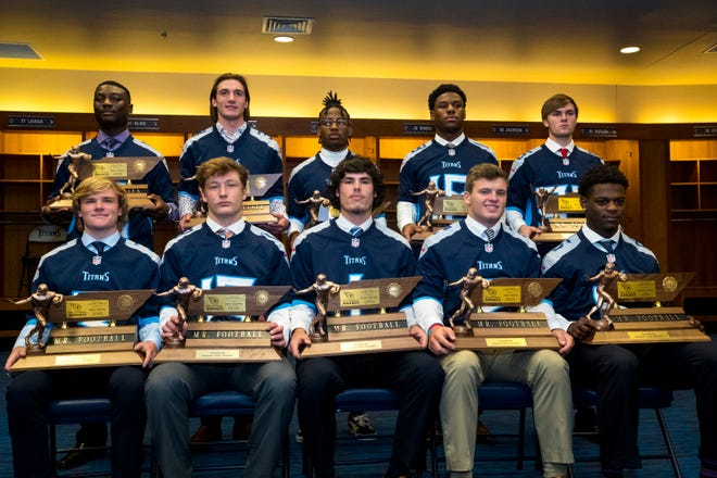 The nine Mr. Football winners and Kicker of the Year winner pose for a group picture Sunday in the Titans locker room at Nissan Stadium. Front row from left: Bryce Hanley, 1A; Aaron Swafford, 2A; Walker Russell, 3A; Cade Ballard, 4A; Deshawn Page, 5A; back row from left: Devon Starling, 6A; Stone Norton, DII-A; Eric Gray, DII-AA; Maurice Hampton, DII-AAA; Garrett Taylor, Kicker of the Year.