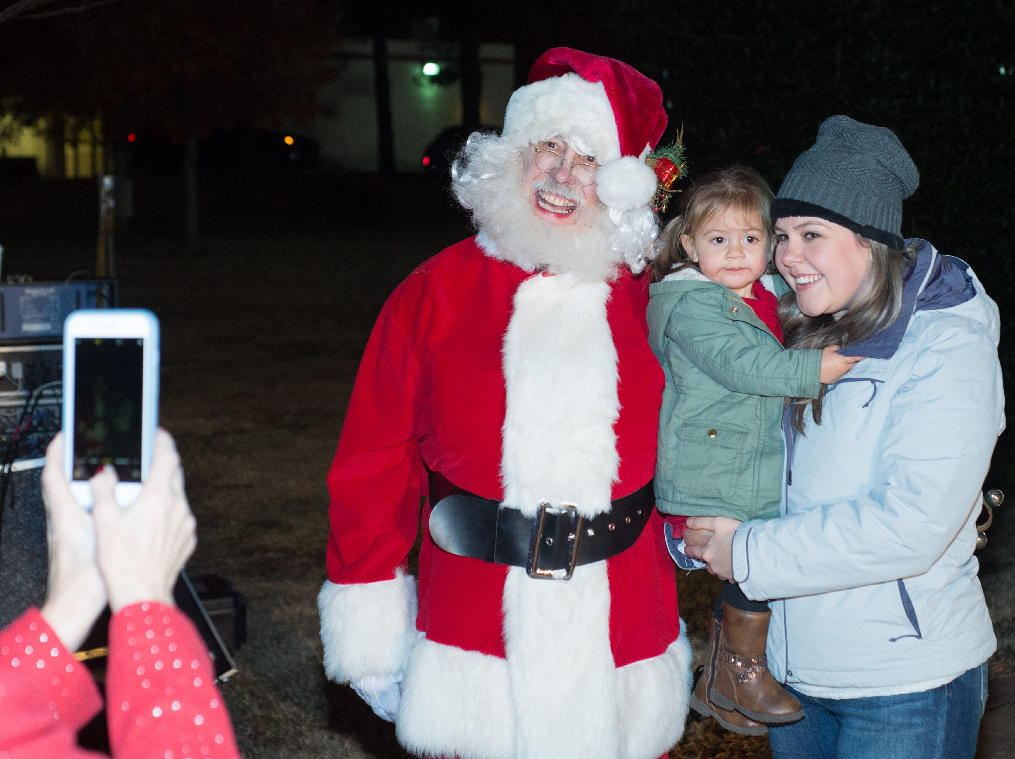 Brylie and Rachel Freeman get their photo with Santa during the Hendersonville HolidayFest Annual Tree Lighting Ceremony at Memorial Park on Sunday, Nov. 25.