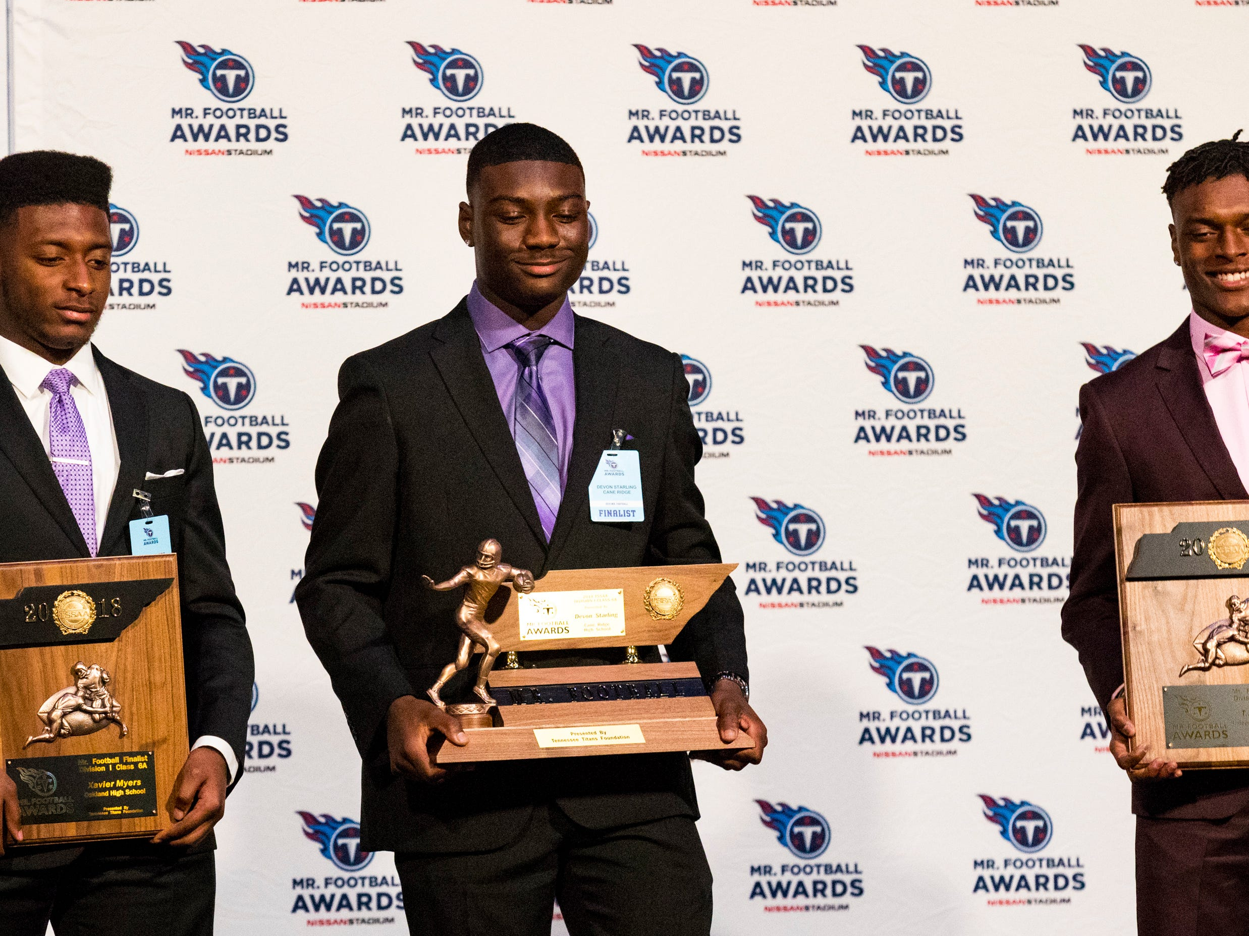 Division 1 Class 6A Mr. Football Devon Starling is flanked by finalists Xavier Myers, left, and T.J. Sheffield during the 2018 Titans Mr. Football Awards Dinner at Nissan Stadium in Nashville on Sunday, Nov. 25, 2018.