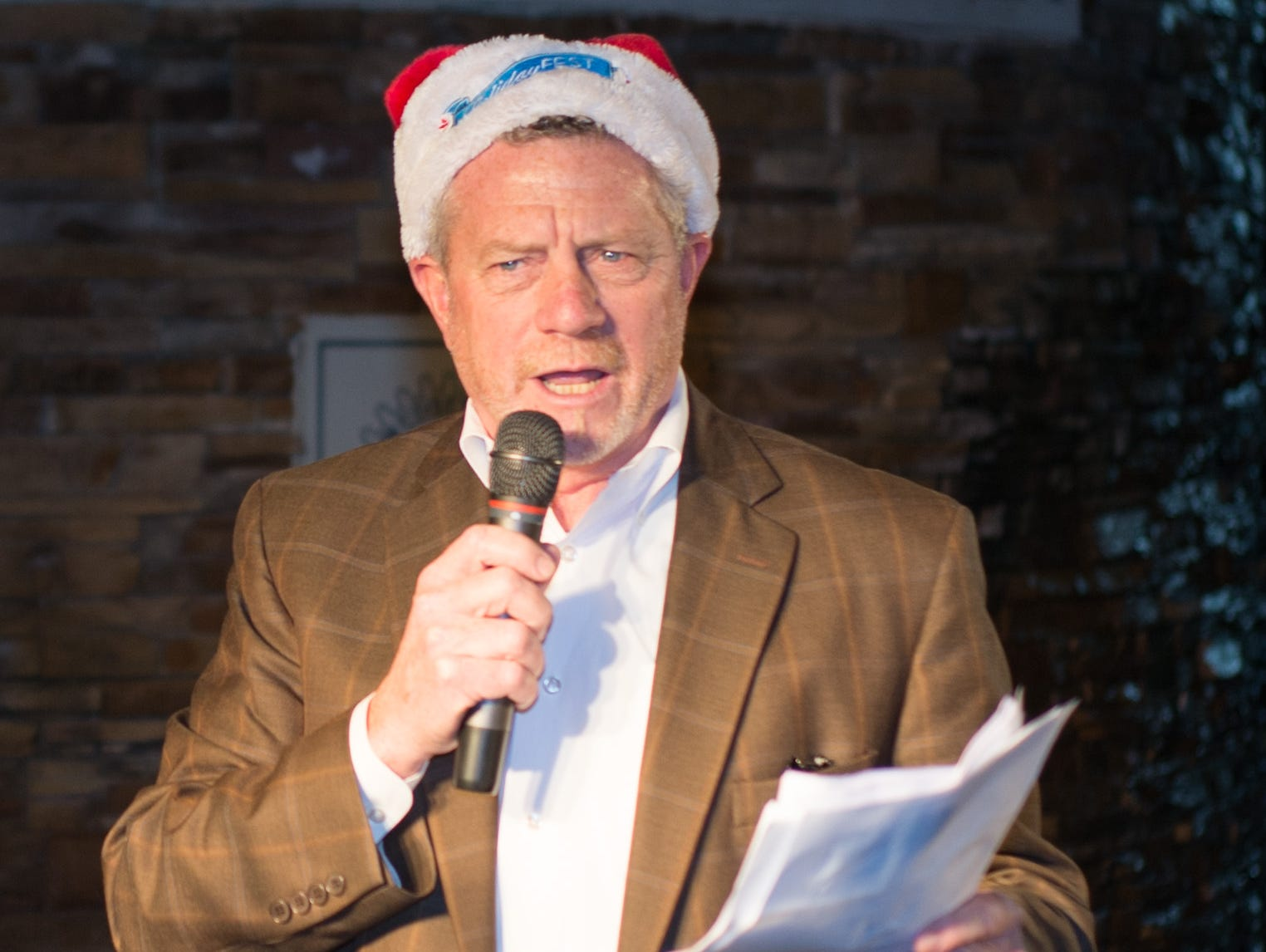2018 HolidayFest President Larry Phillips speaks during the Hendersonville HolidayFest Annual Tree Lighting Ceremony at Memorial Park on Sunday, Nov. 25.