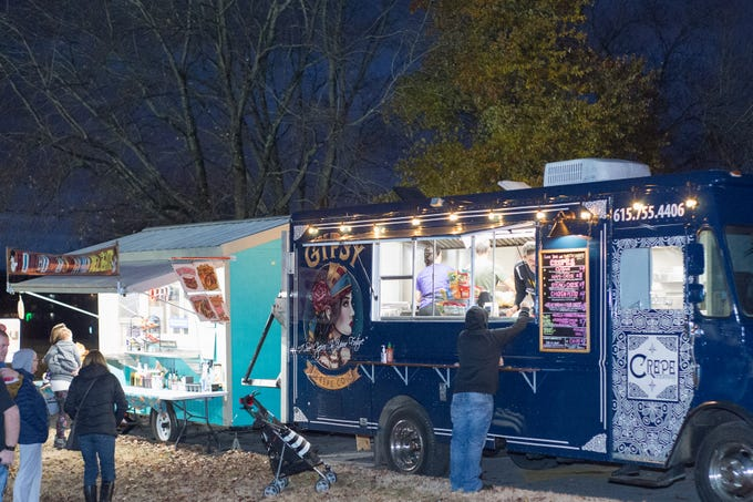 Food trucks feed the crowd during the Hendersonville HolidayFest Annual Tree Lighting Ceremony at Memorial Park on Sunday, Nov. 25.
