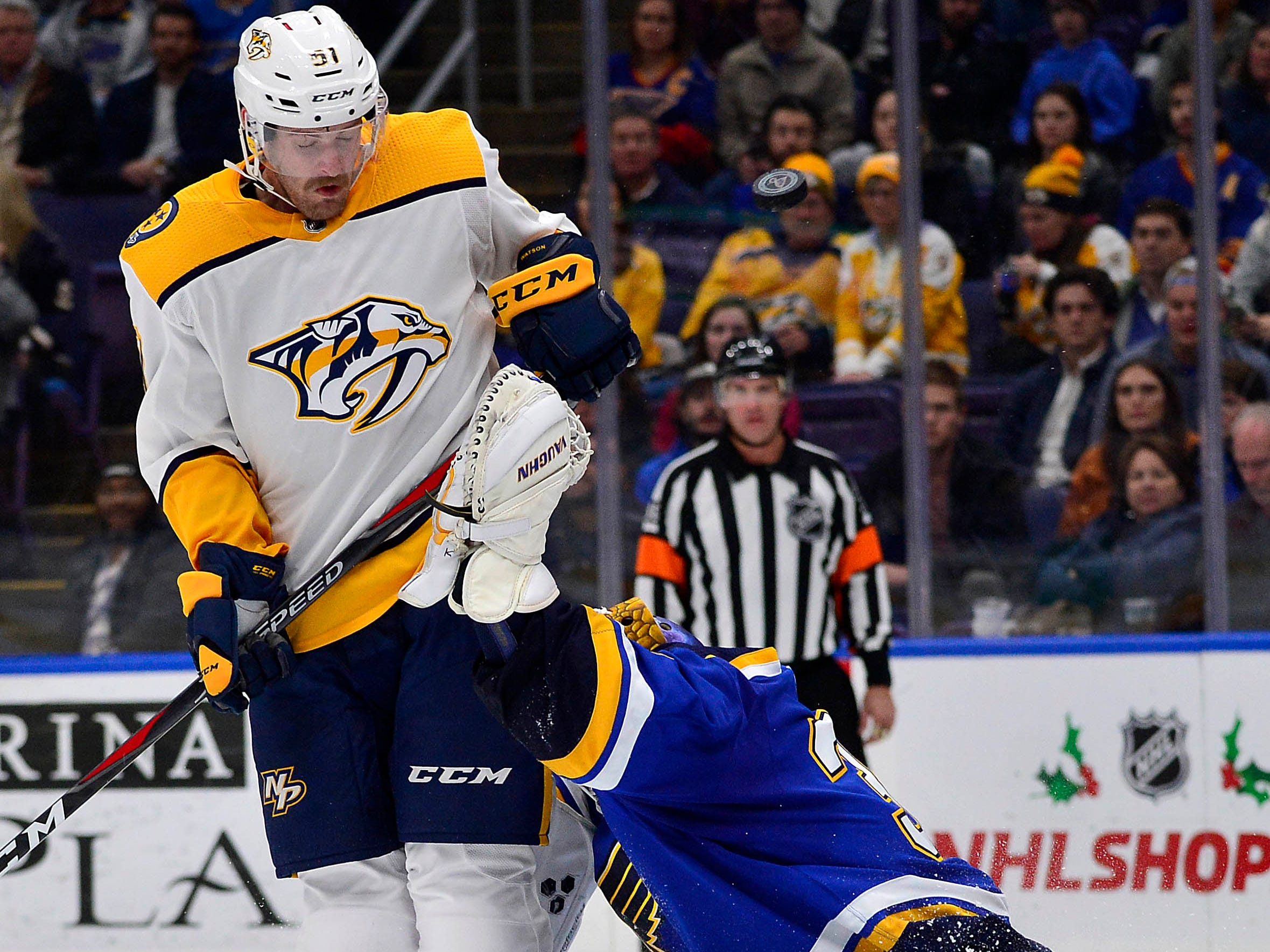 Nashville Predators left wing Austin Watson (51) leaps as he attempts to block St. Louis Blues goaltender Jake Allen (34) during the second period at Enterprise Center.