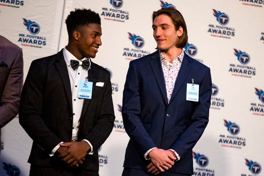 Division 2 Class A Mr. Football Stone Norton, right, talks with his Davidson Academy teammate and fellow finalist Da'Joun Hewitt as they are introduced during the 2018 Titans Mr. Football Awards Dinner at Nissan Stadium in Nashville on Sunday, Nov. 25, 2018.