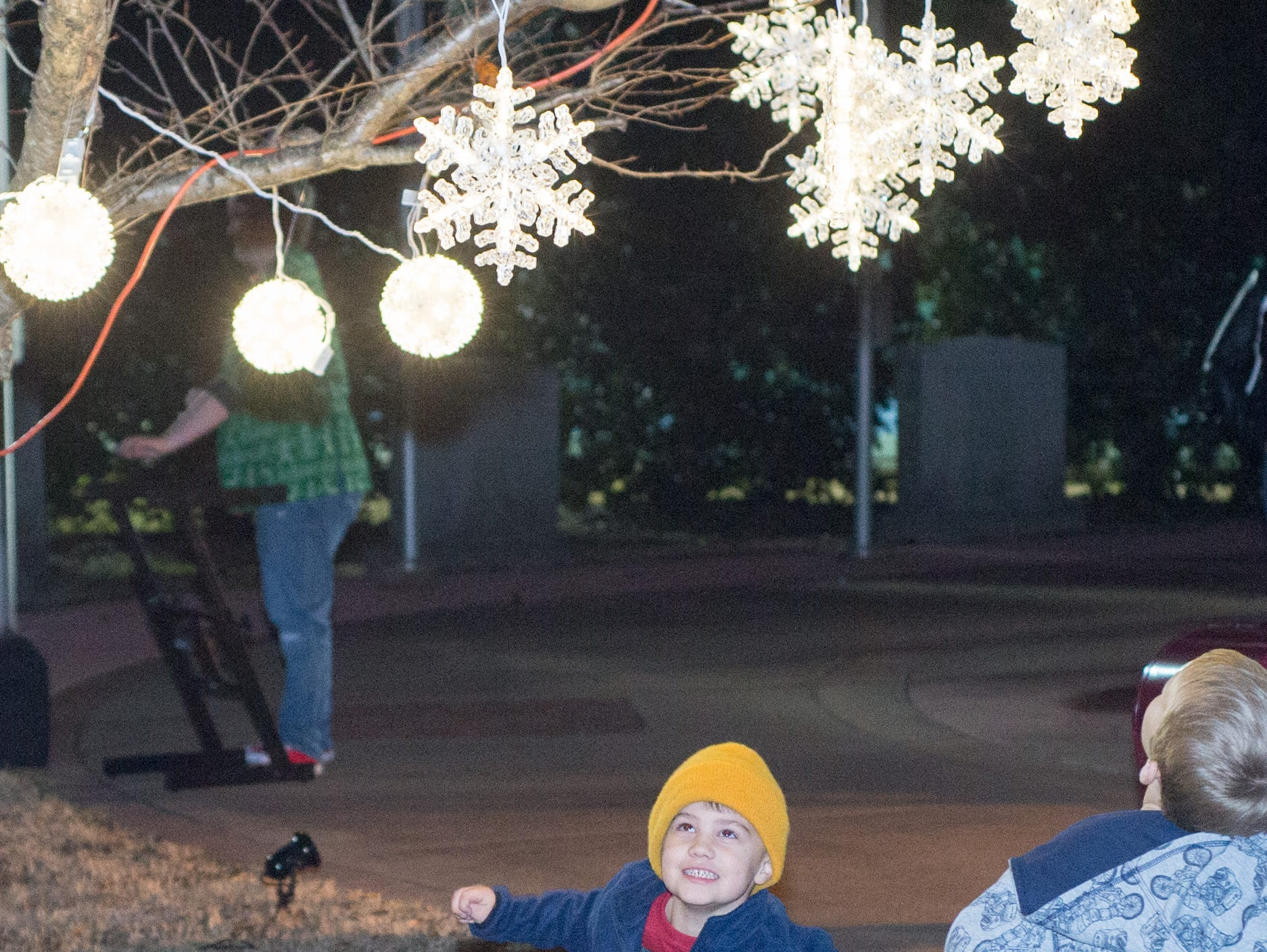 Kids enjoy the lights while waiting for the main tree lighting during the Hendersonville HolidayFest Annual Tree Lighting Ceremony at Memorial Park on Sunday, Nov. 25.